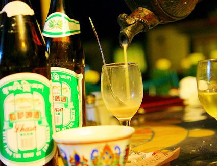 Barley wine and butter tea served in a local bar, Lhasa, Tibet Autonomous Region, China