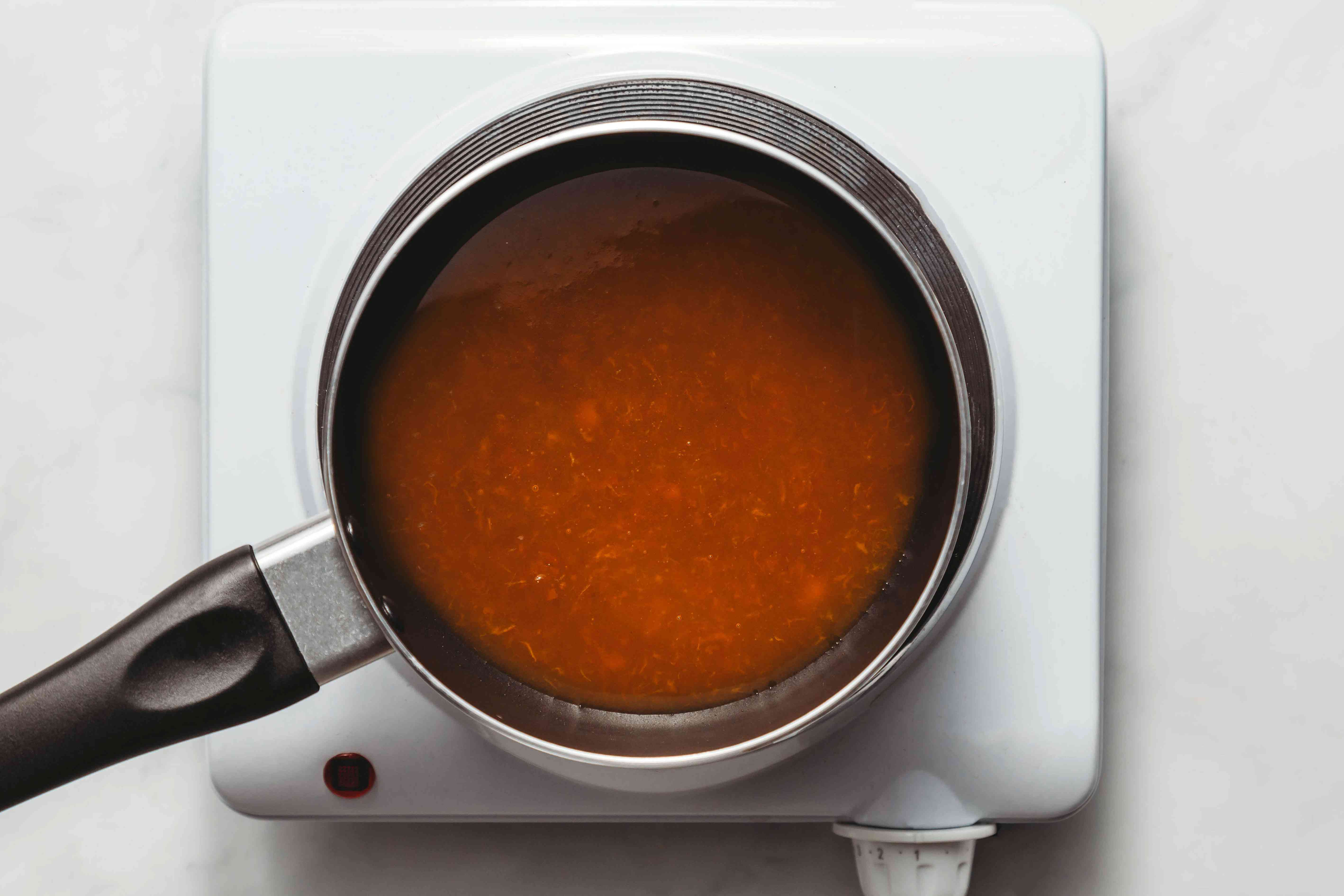 heat the apricot jam in a small saucepan along with about a tablespoon of water
