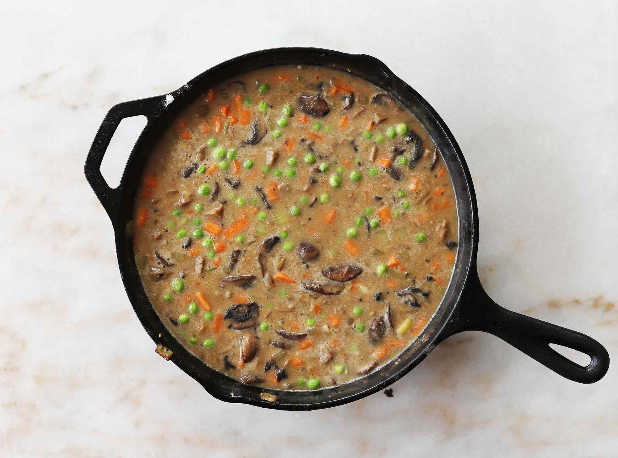 pot pie filling in a cast iron skillet