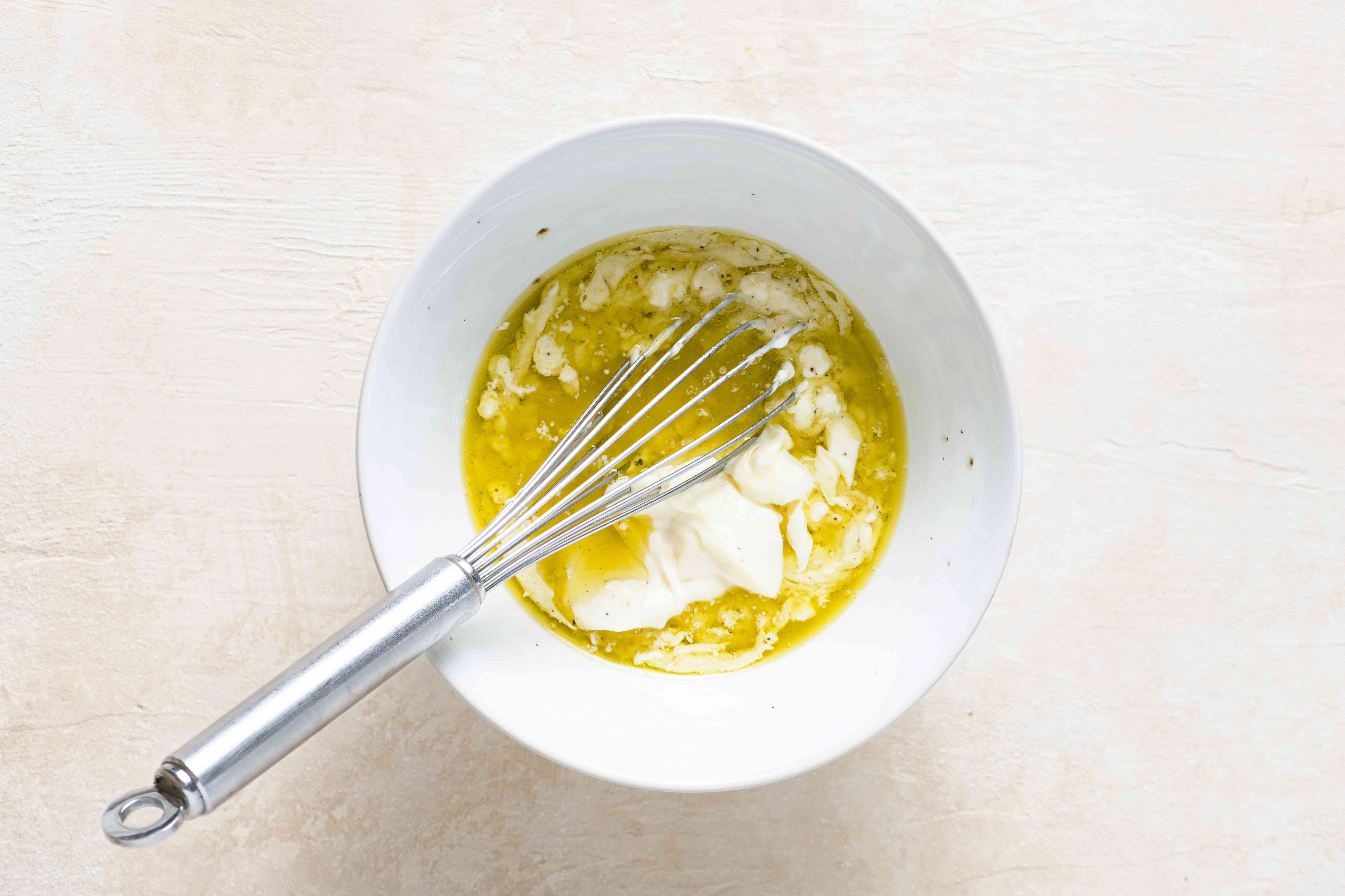 mayonnaise, olive oil, vinegar, mustard, salt and pepper in a bowl