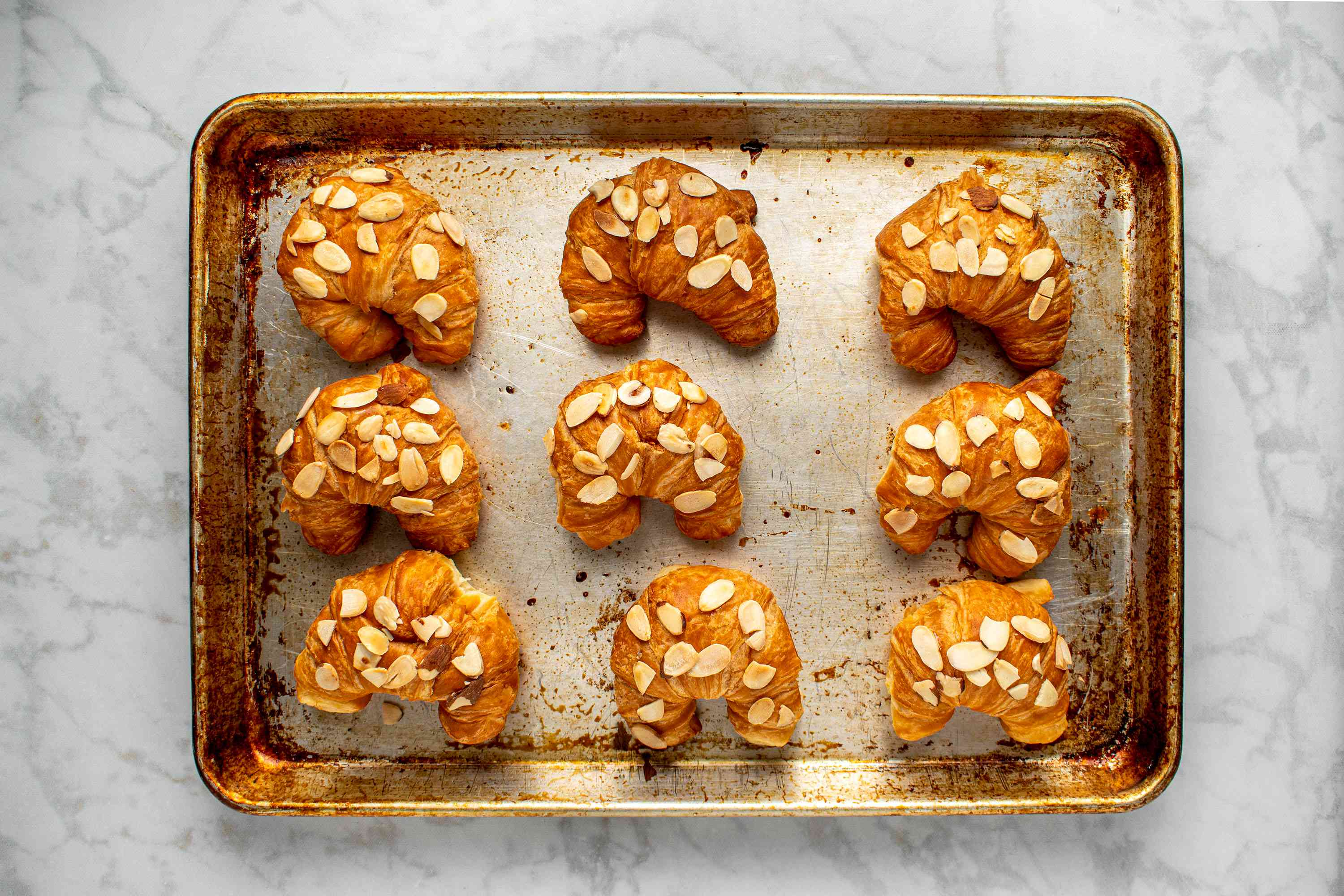 baked Classic French Almond Croissants on a baking sheet