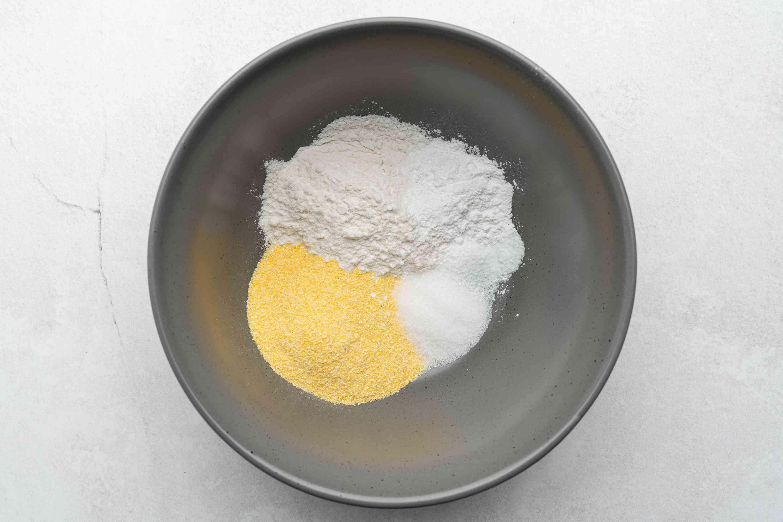 combine the flour, cornmeal, sugar, salt, and baking powder in a bowl