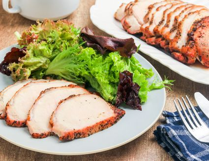 Easy 4-ingredient pork roast on a plate with salad