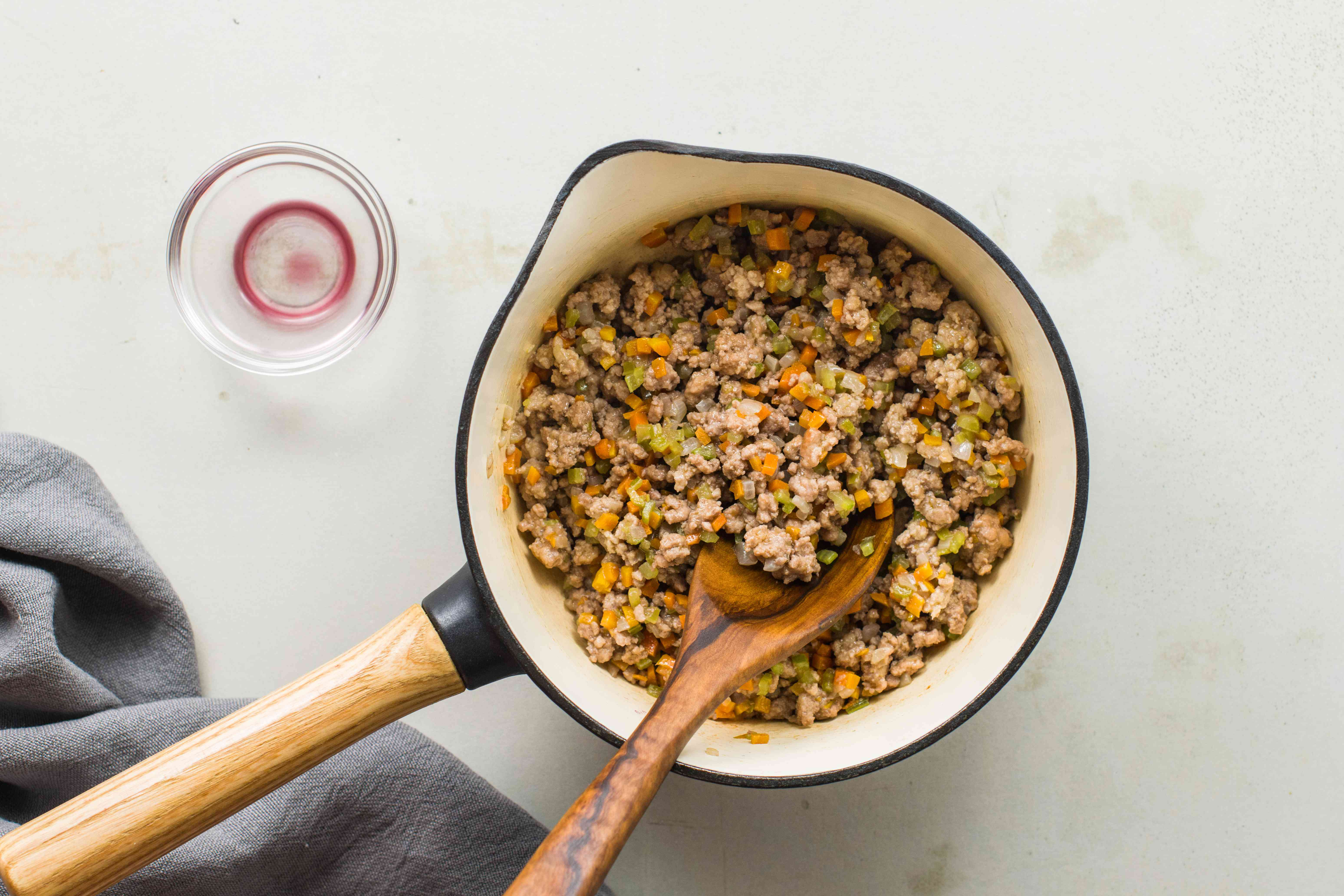 Add wine to meat sauce