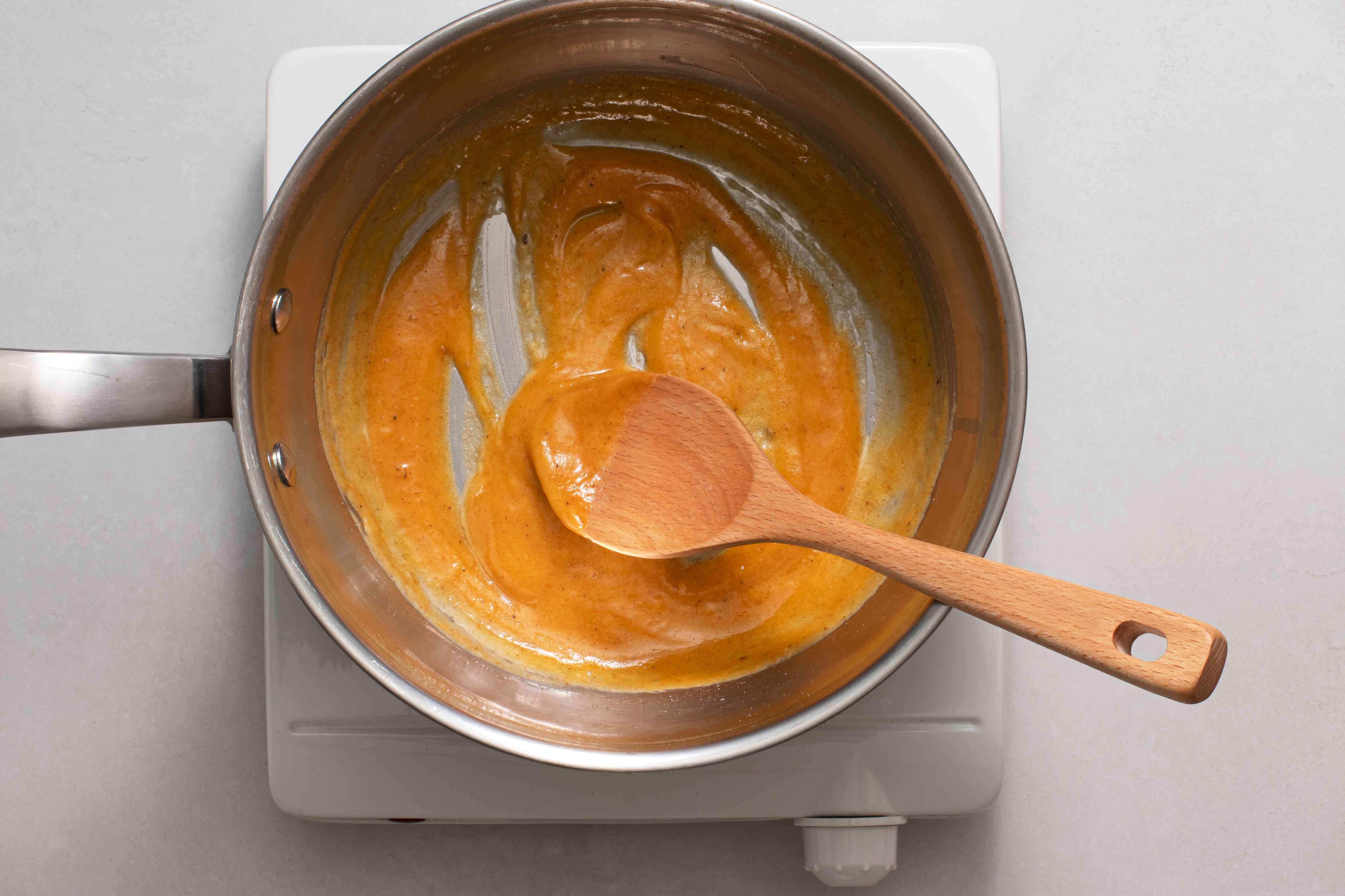 flour, salt, cayenne, and nutmeg in a pan