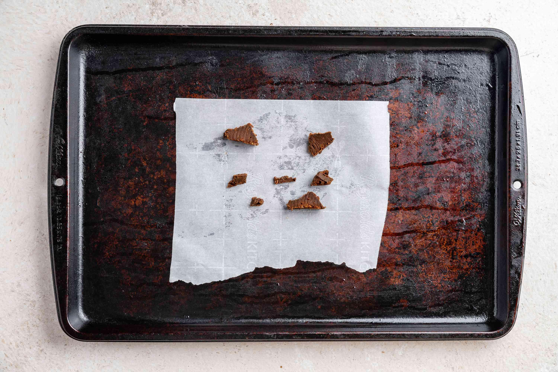 belacan slices on a baking sheet