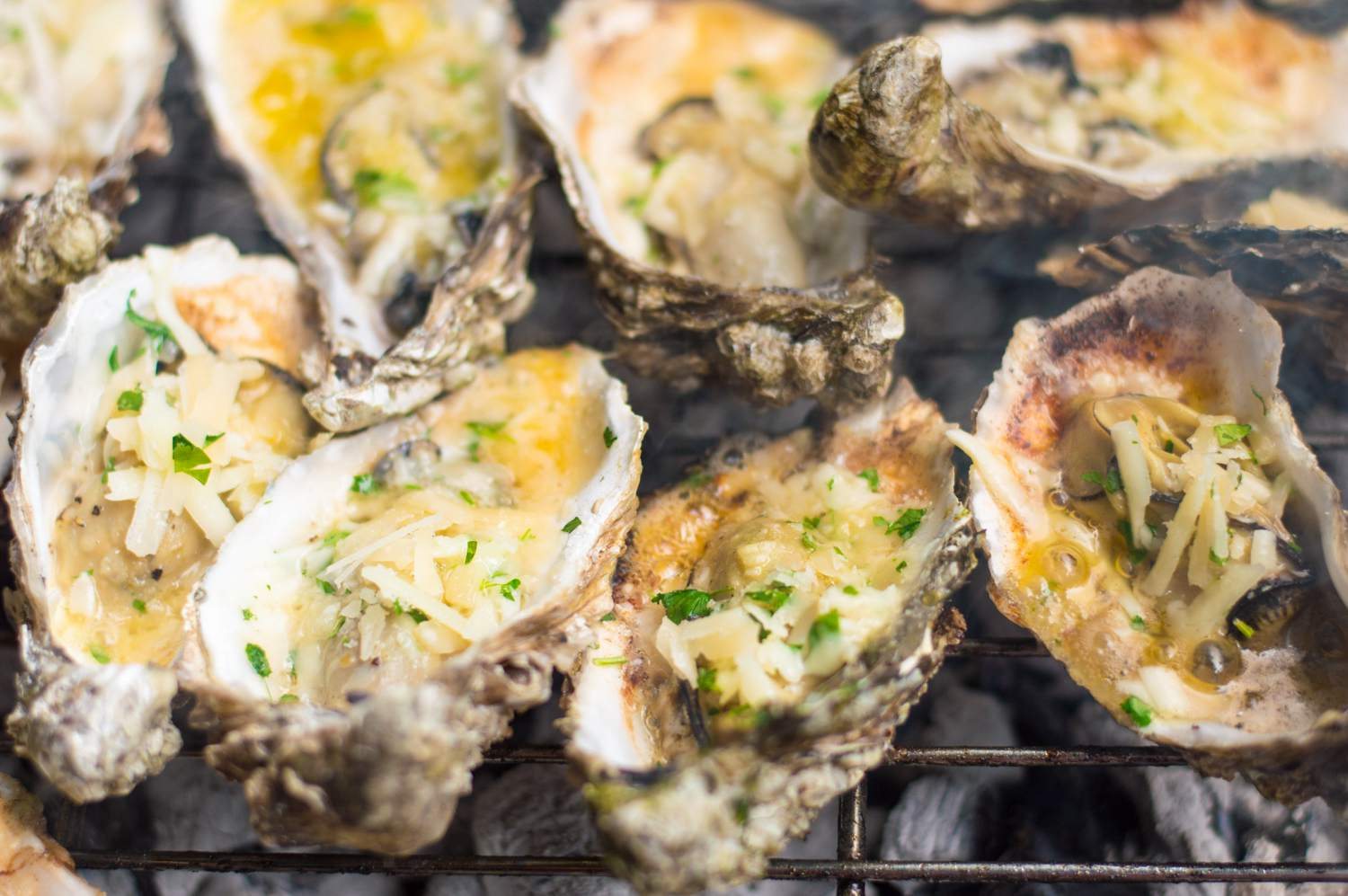 Charbroiled oysters with cheese
