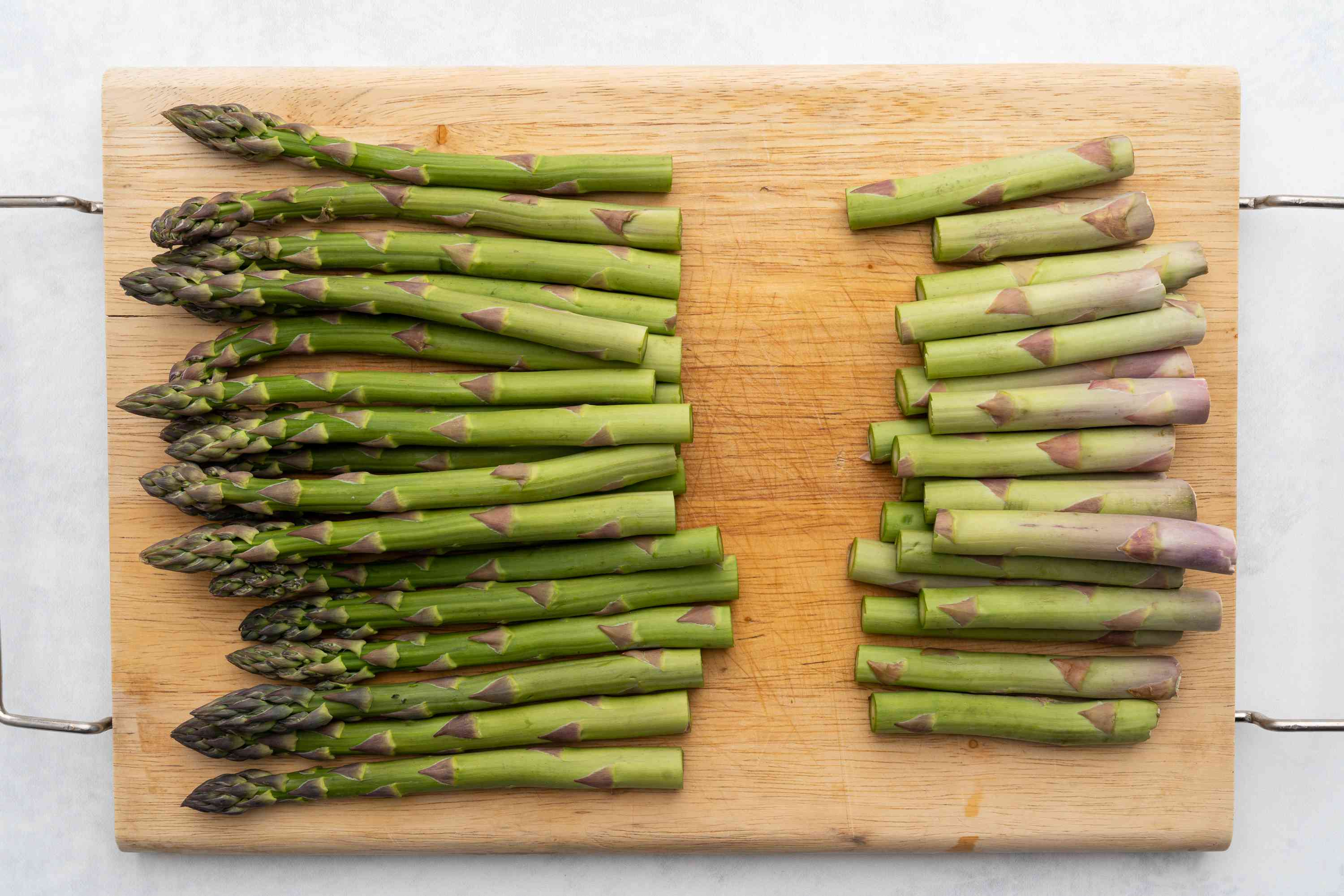 Trimmed asparagus spears on a cutting board