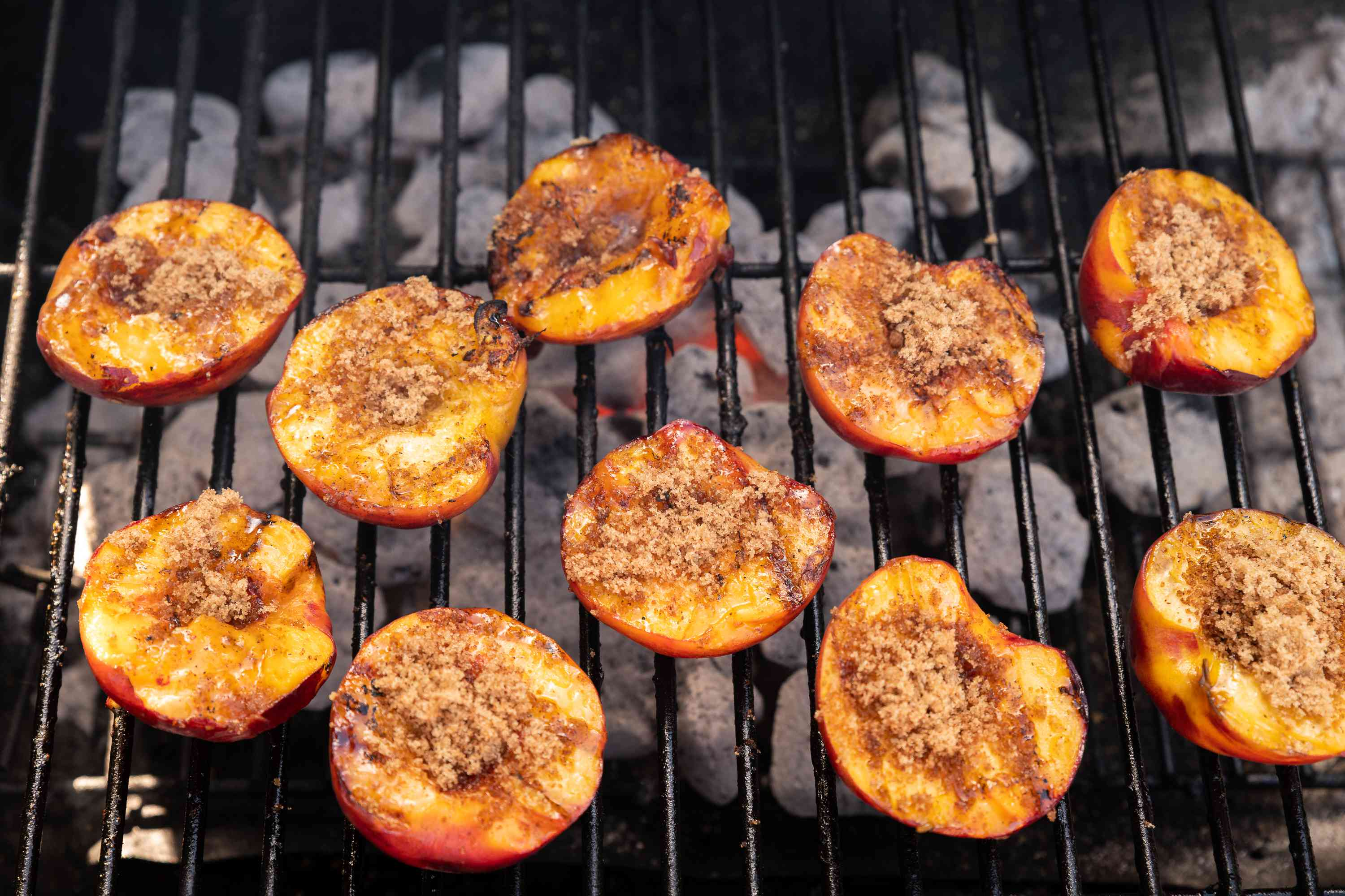 flip the peach halves over on the grill, sprinkle with the cinnamon and sugar