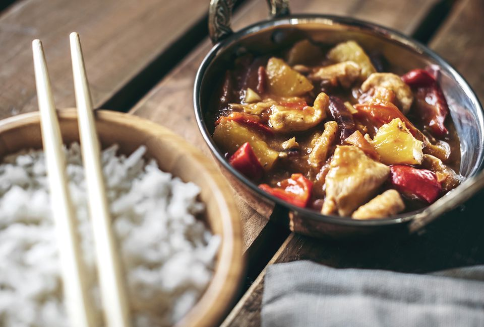 Bowls of Chinese spicy chicken dish and rice