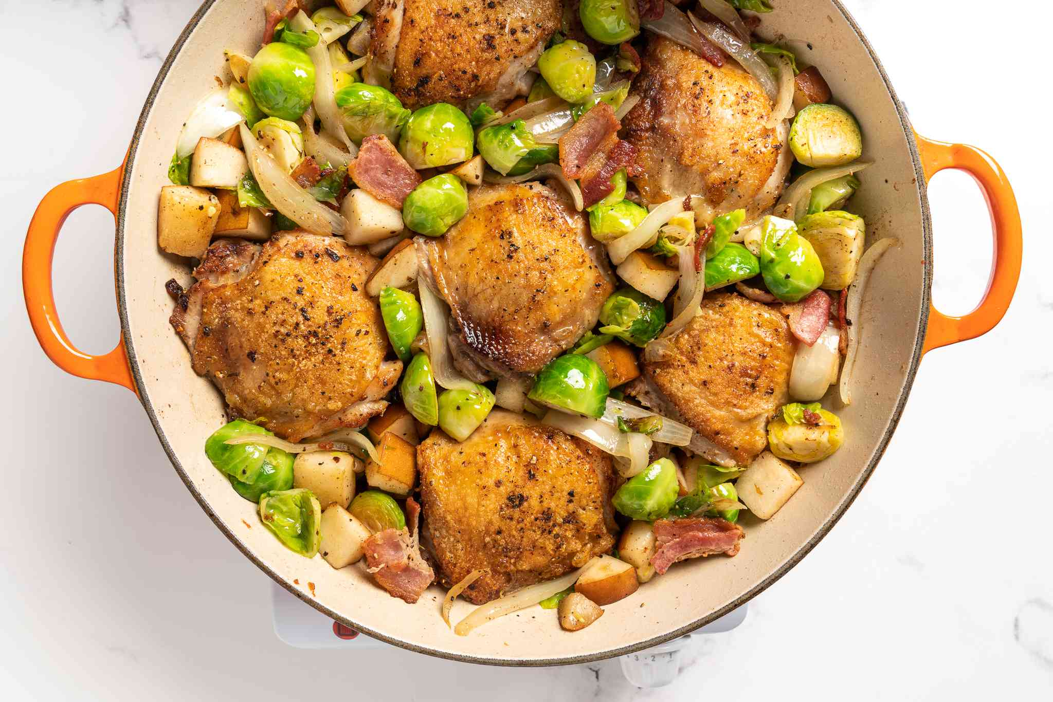 chicken and Brussels sprouts mixture in a skillet