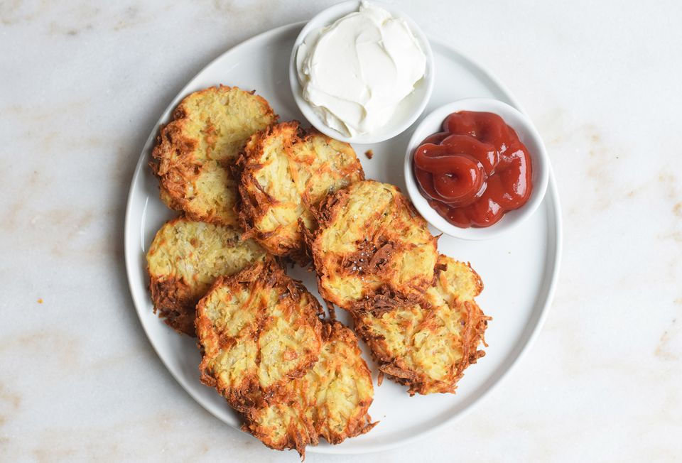 air fryer hash browns served with ketchup and sour cream