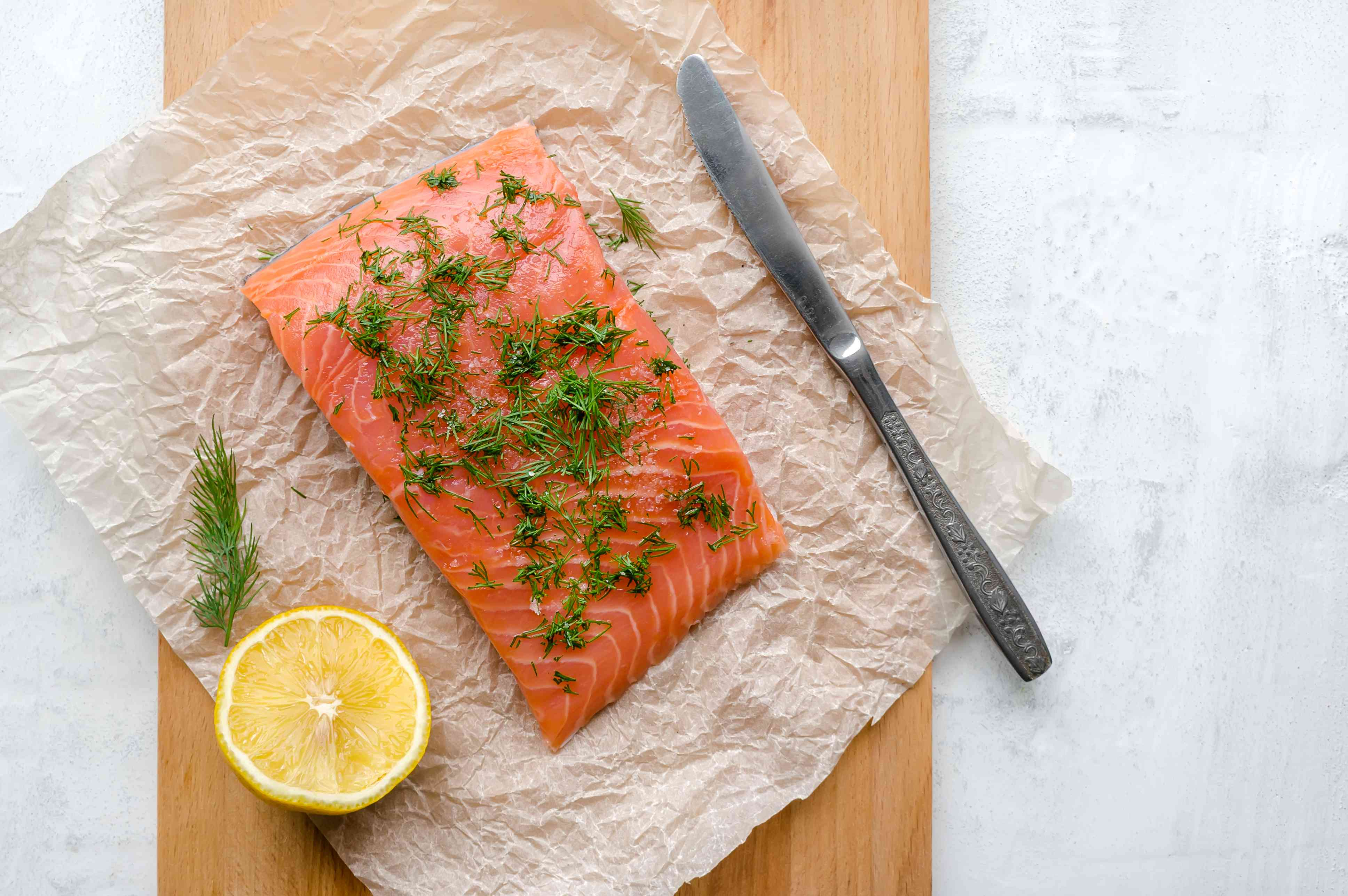 Gravlax. Salted salmon steak with dil. Top view.