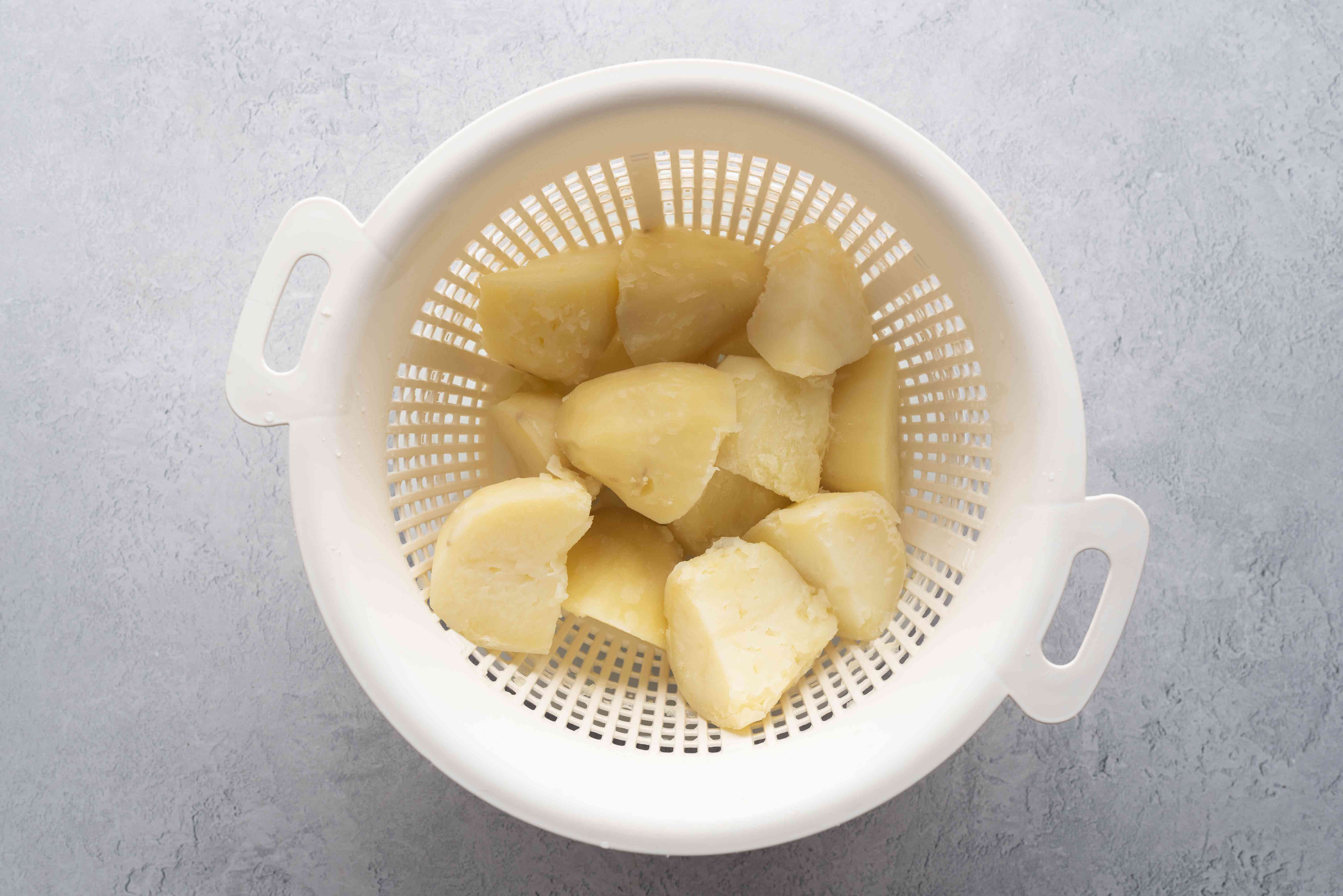 A colander with cooked potatoes