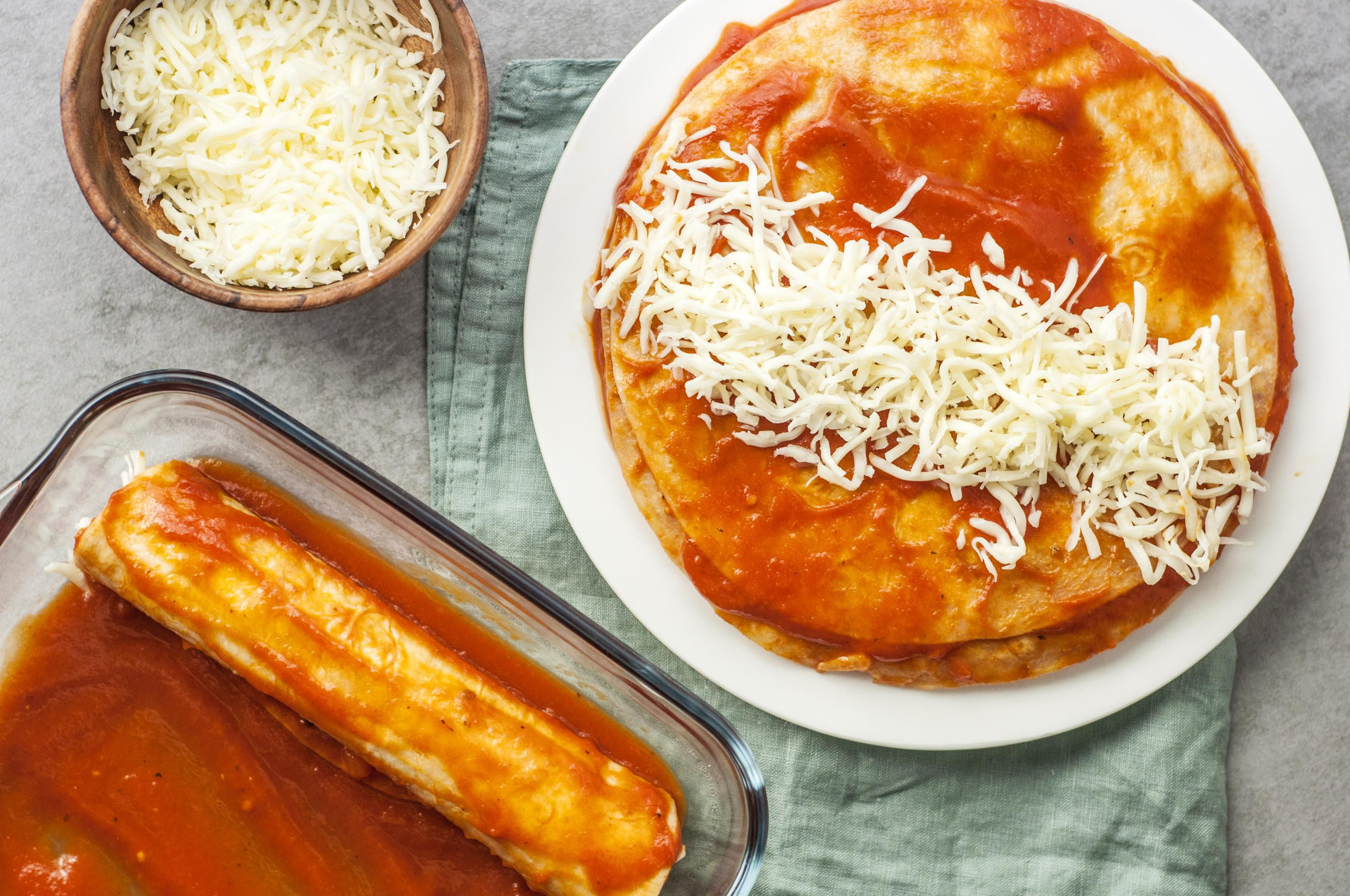 Tortillas in enchilada sauce with cheese