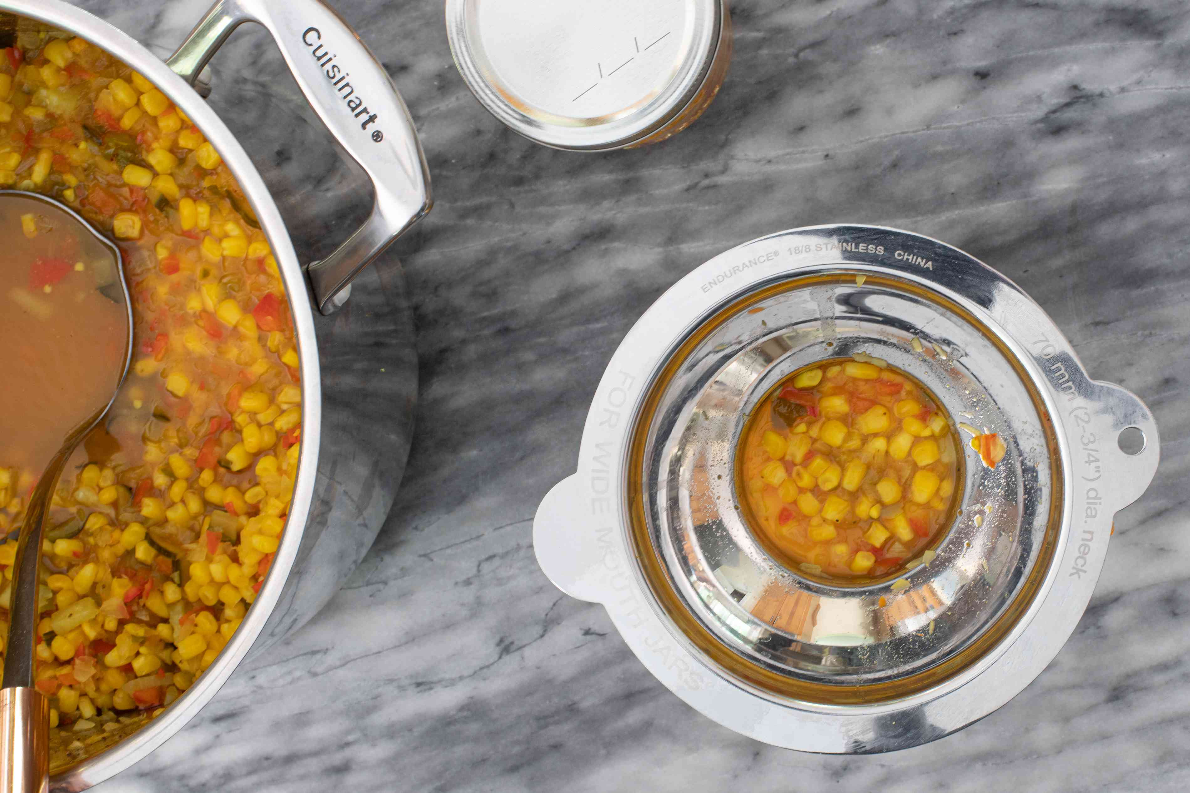 Filling canning jars with corn relish.