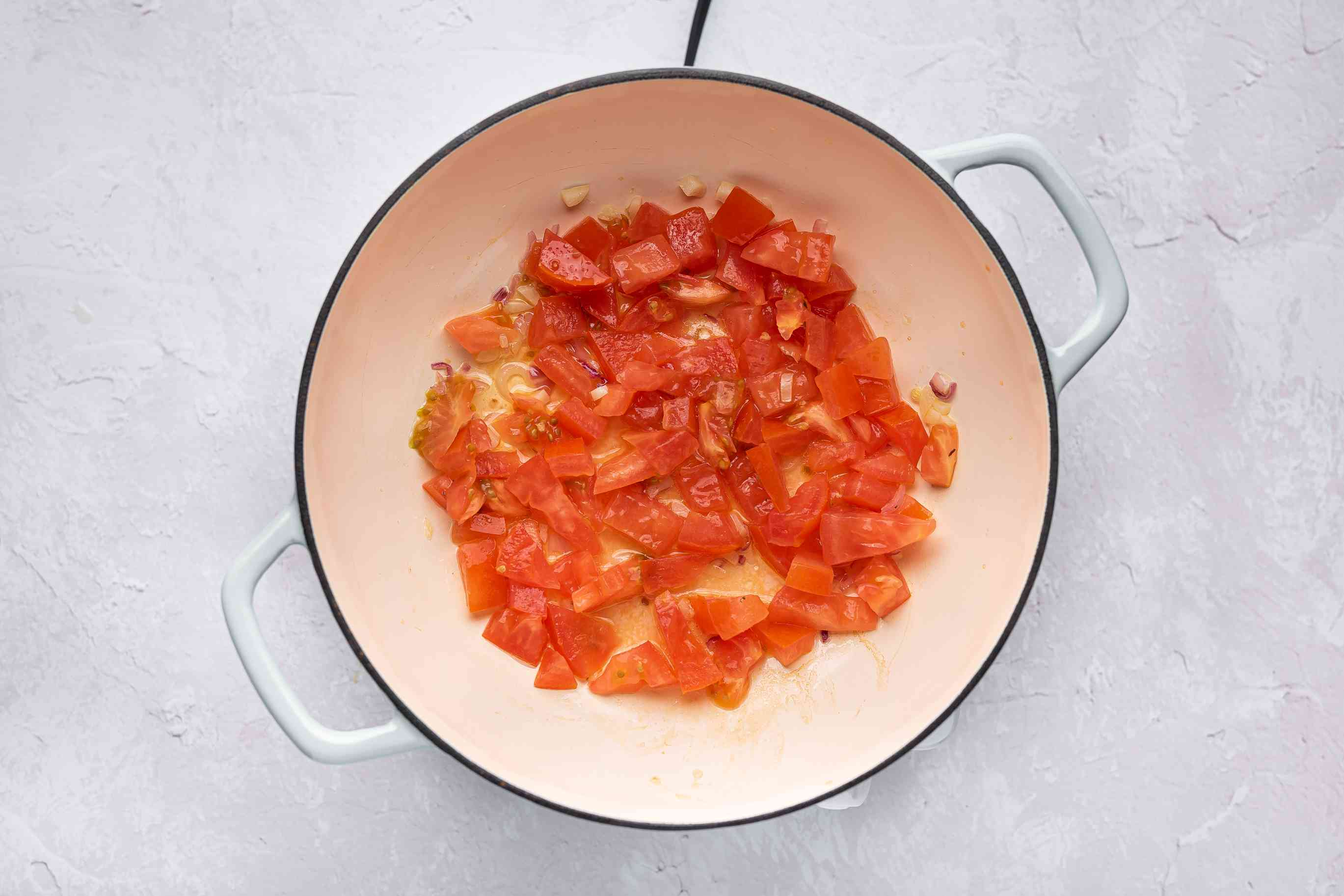 Saute the minced garlic, sliced shallots and diced tomato in a pot