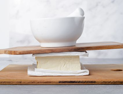Place cutting board on top