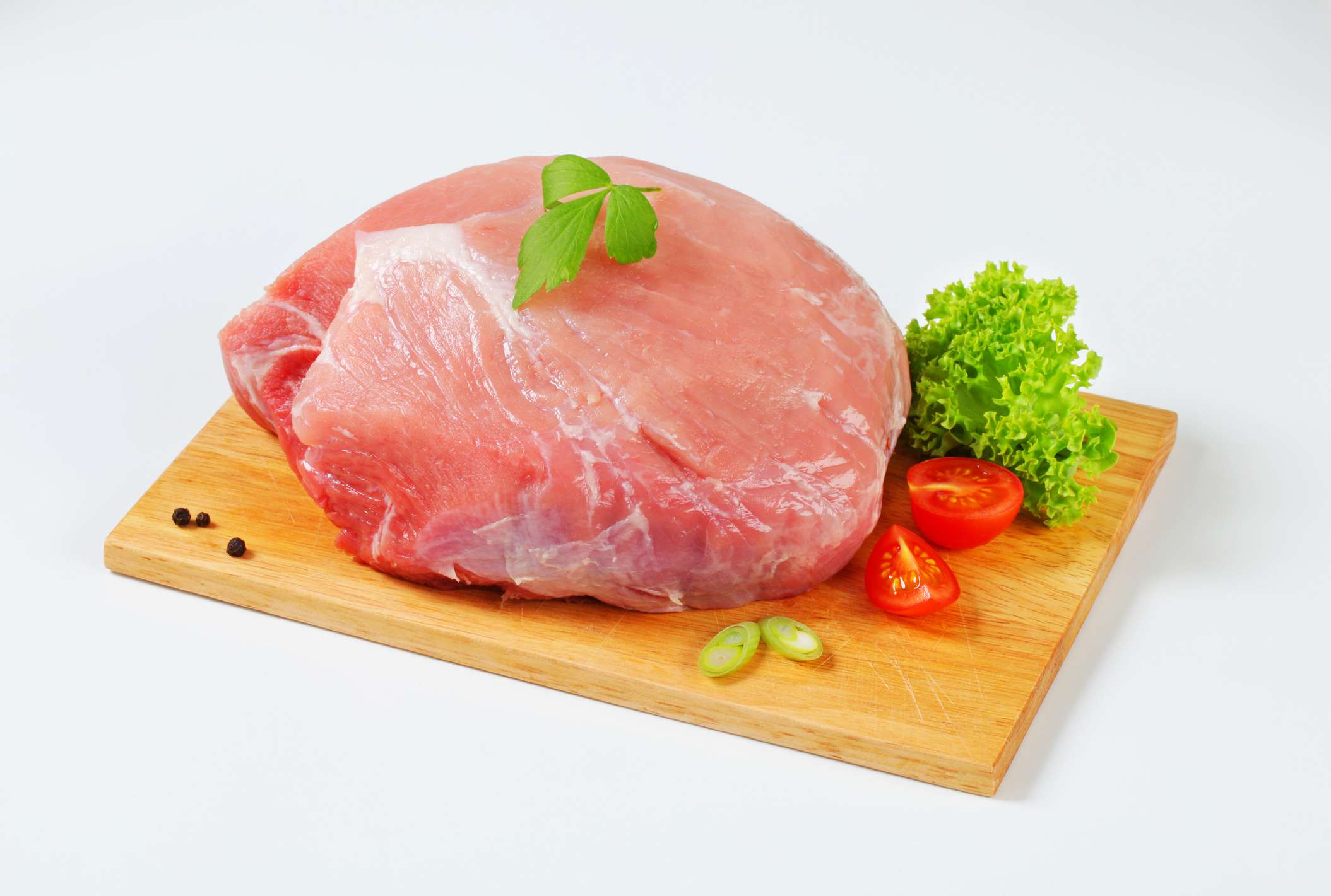 Raw joint pork meat on a cutting board
