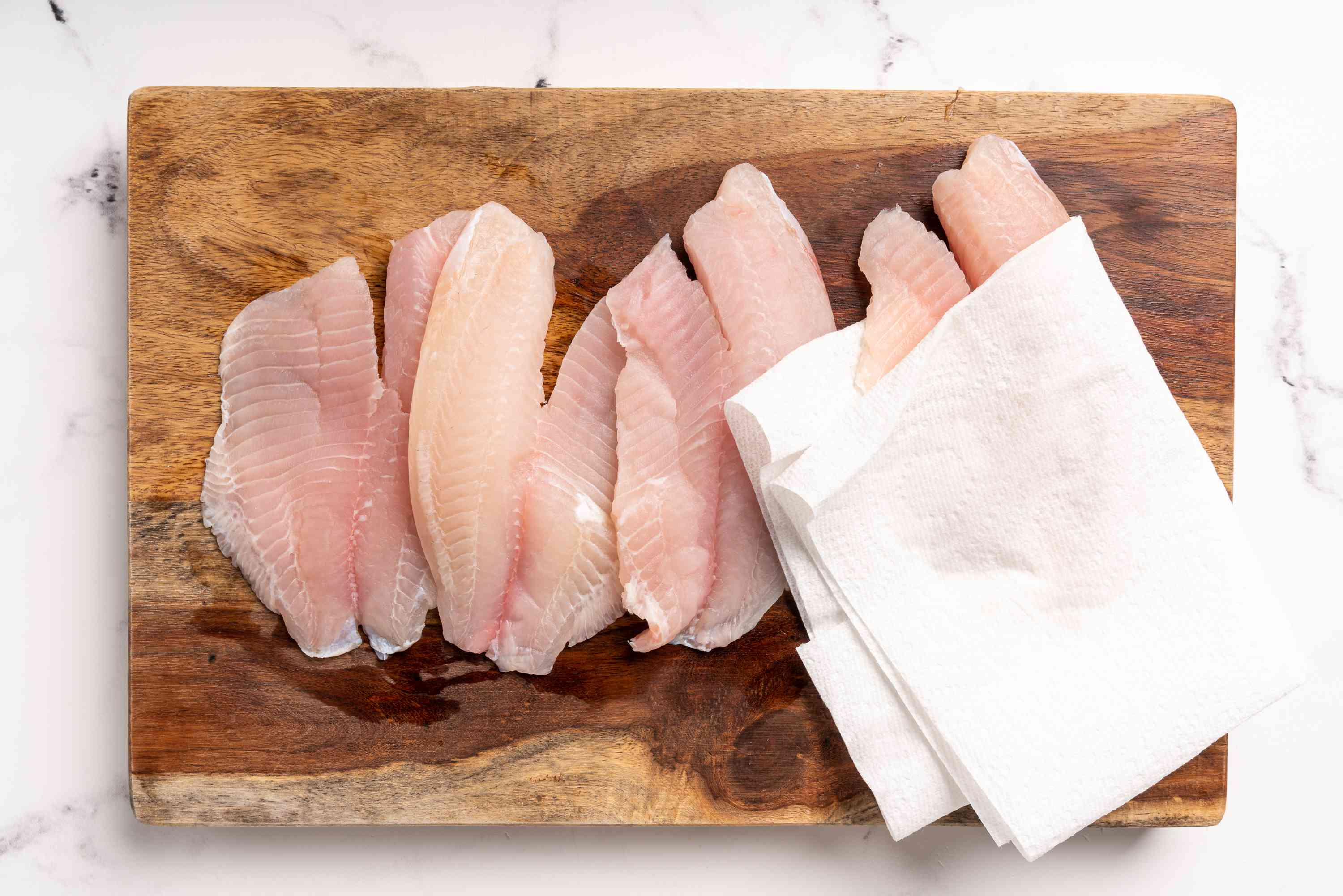 tilapia patted dry with a paper towel