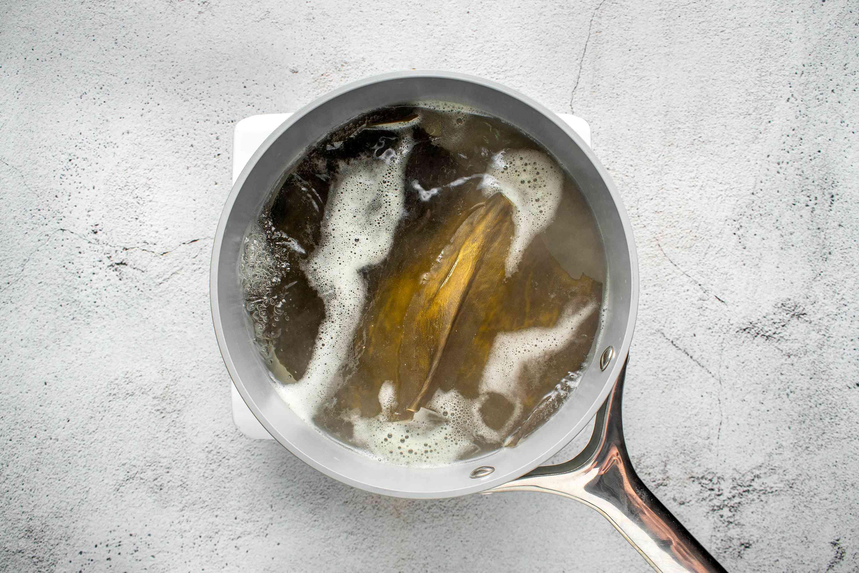 water and kombu in a medium saucepan