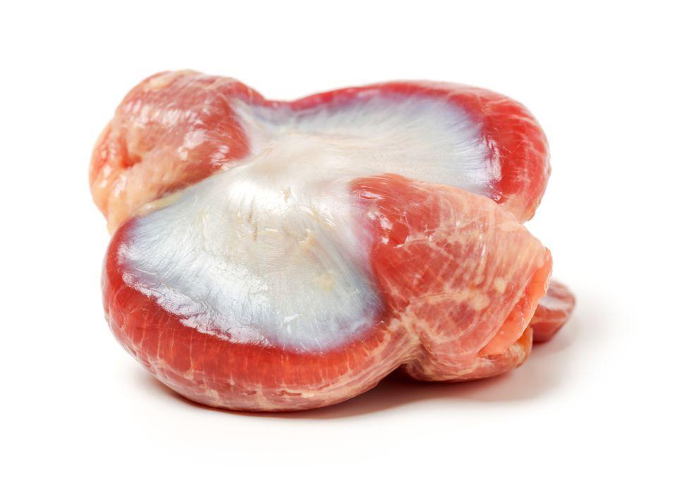 Raw Chicken gizzards on white background