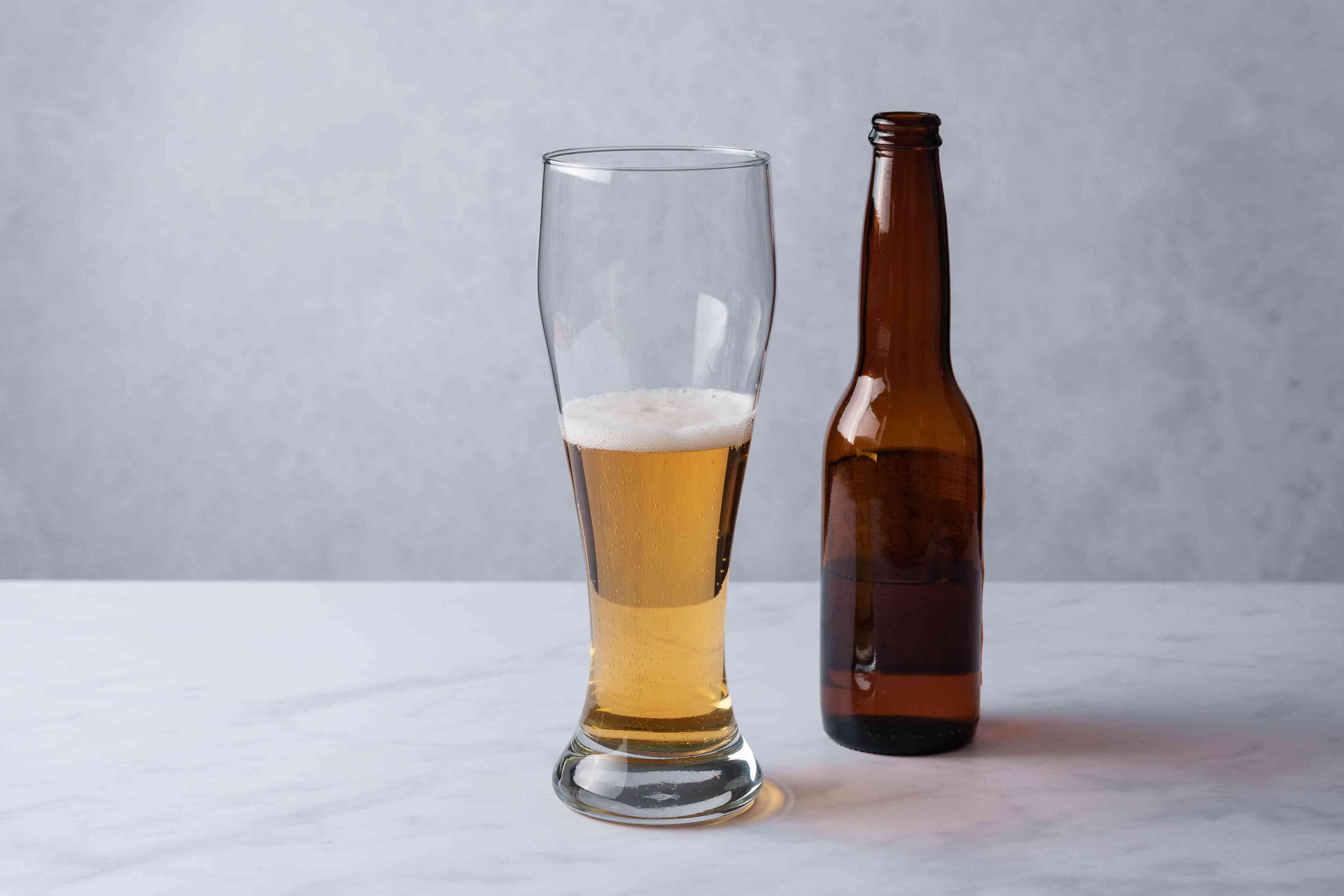 Pour the beer into a pint glass until it is about half full