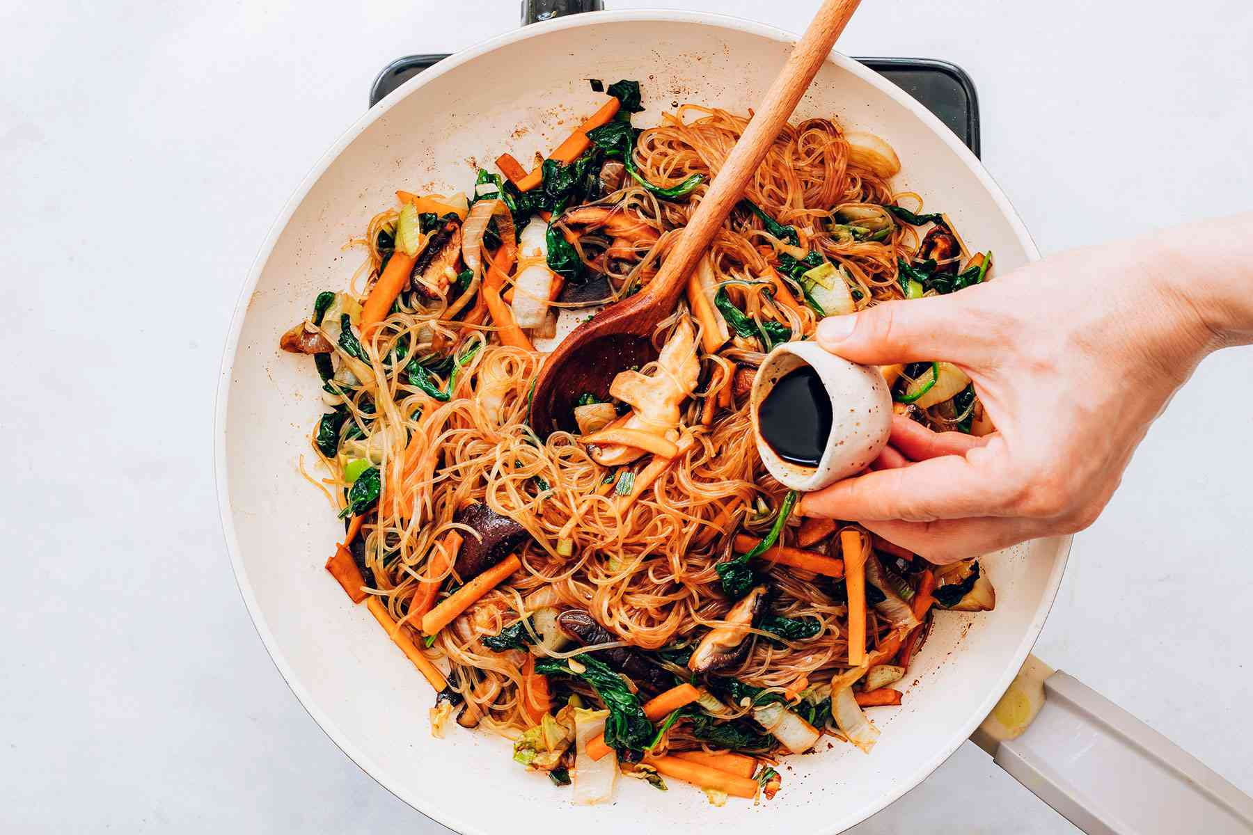 Korean Stir-Fried Noodles (Jap Chae or Chap Chae) cooking in a pan