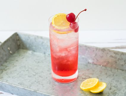 Singapore sling cocktail on a tray