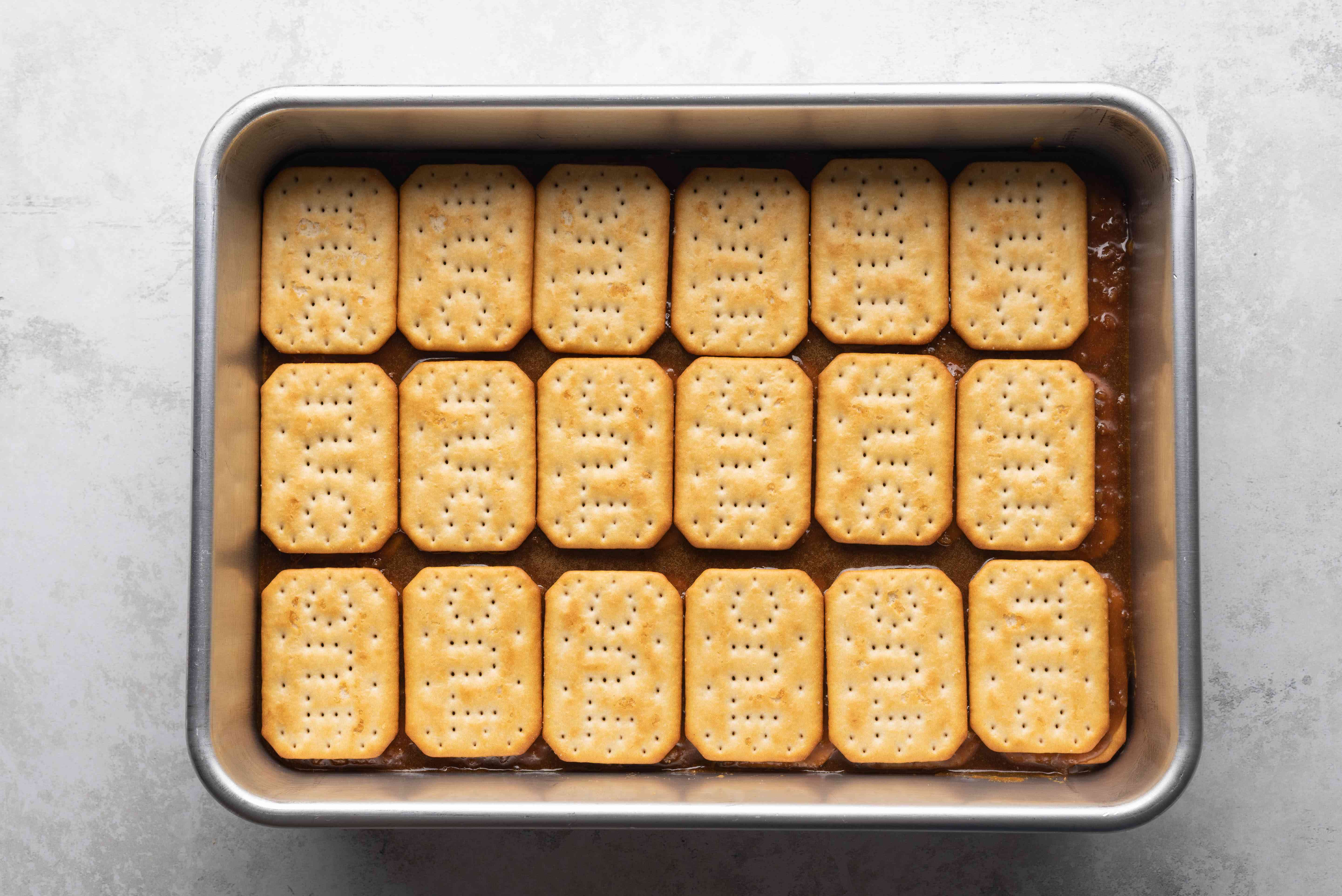 crackers on top of the sugar mixture in the baking dish