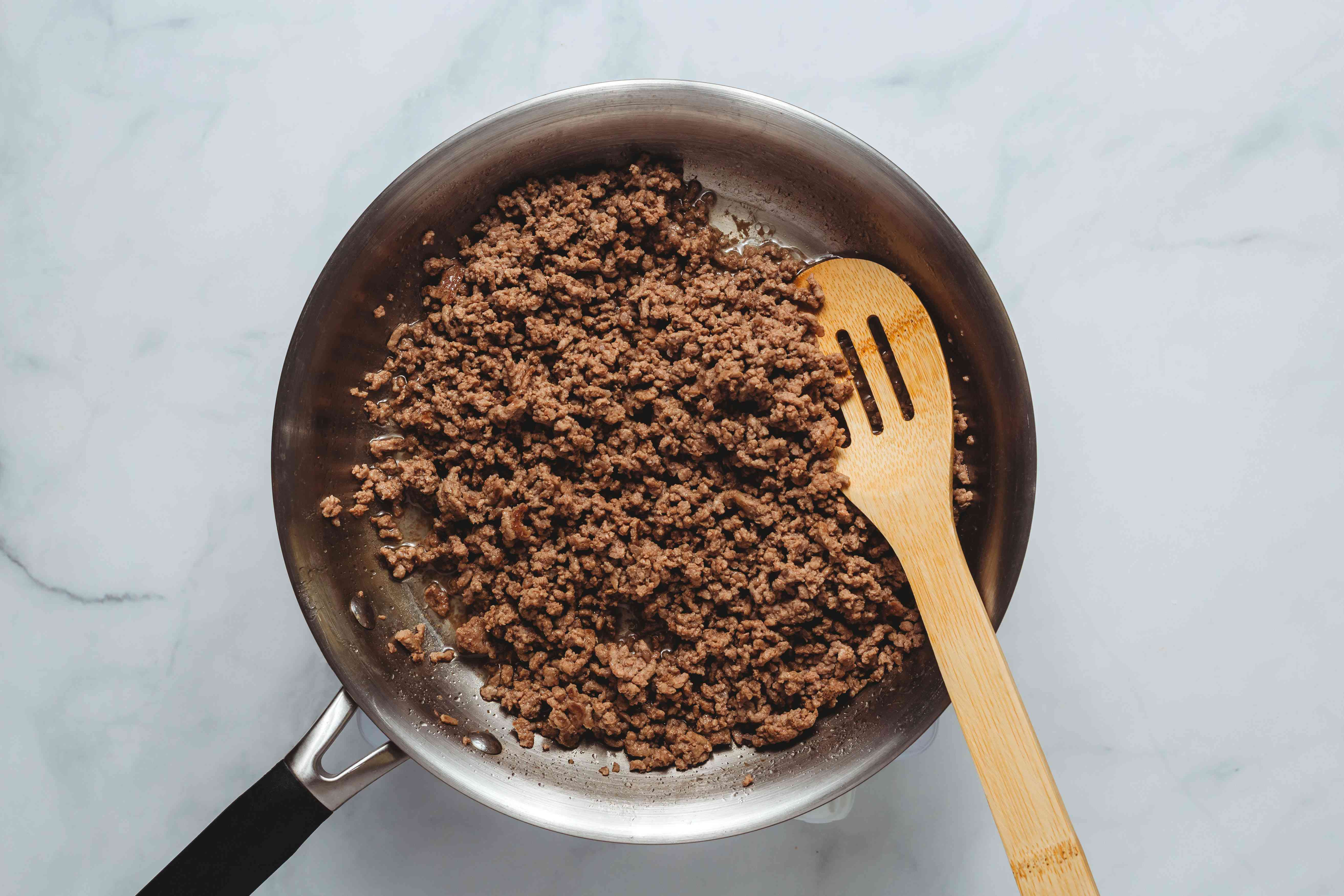 ground beef cooking in a pan