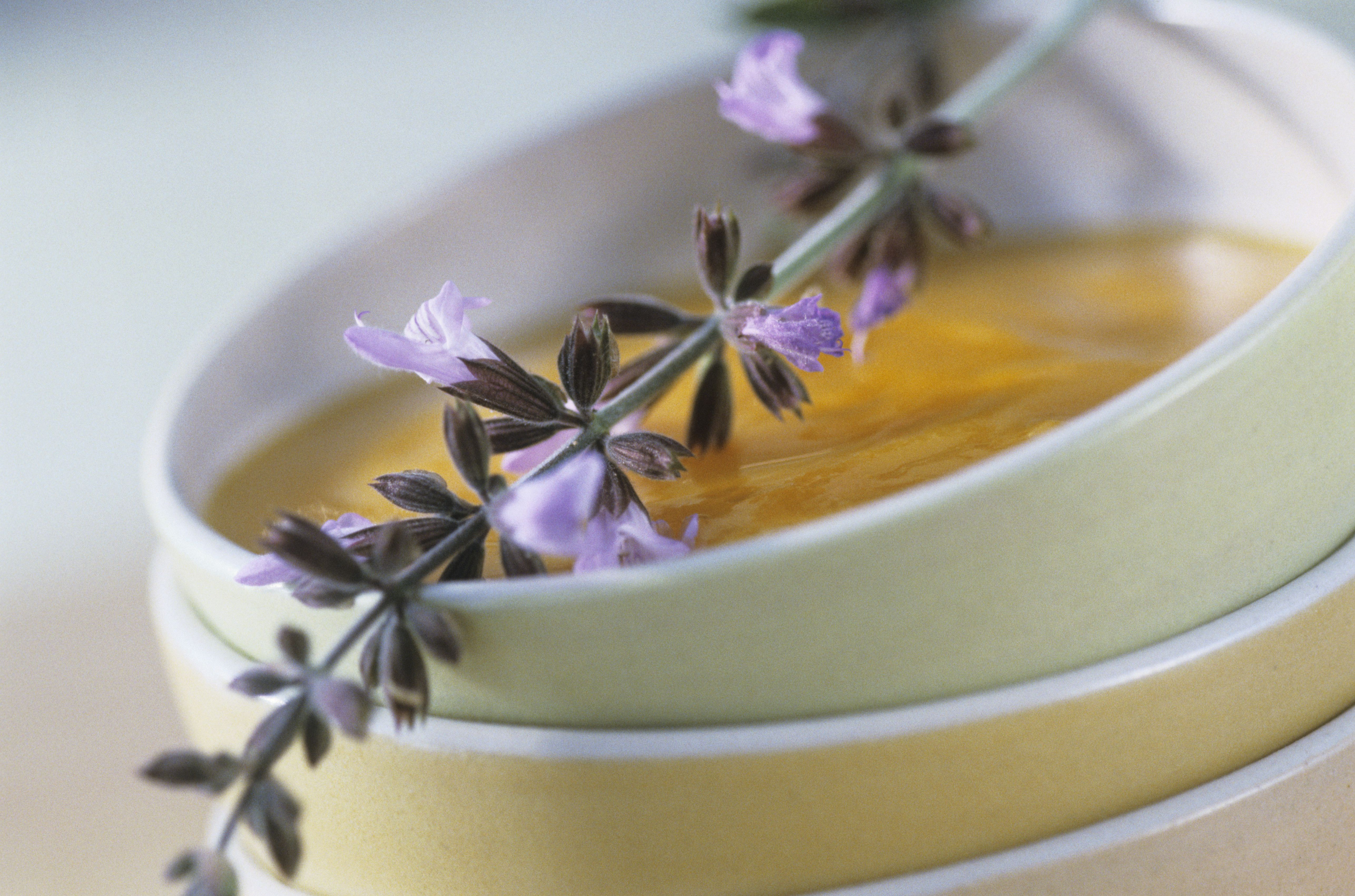 Creamed carrot soup with sage flowers