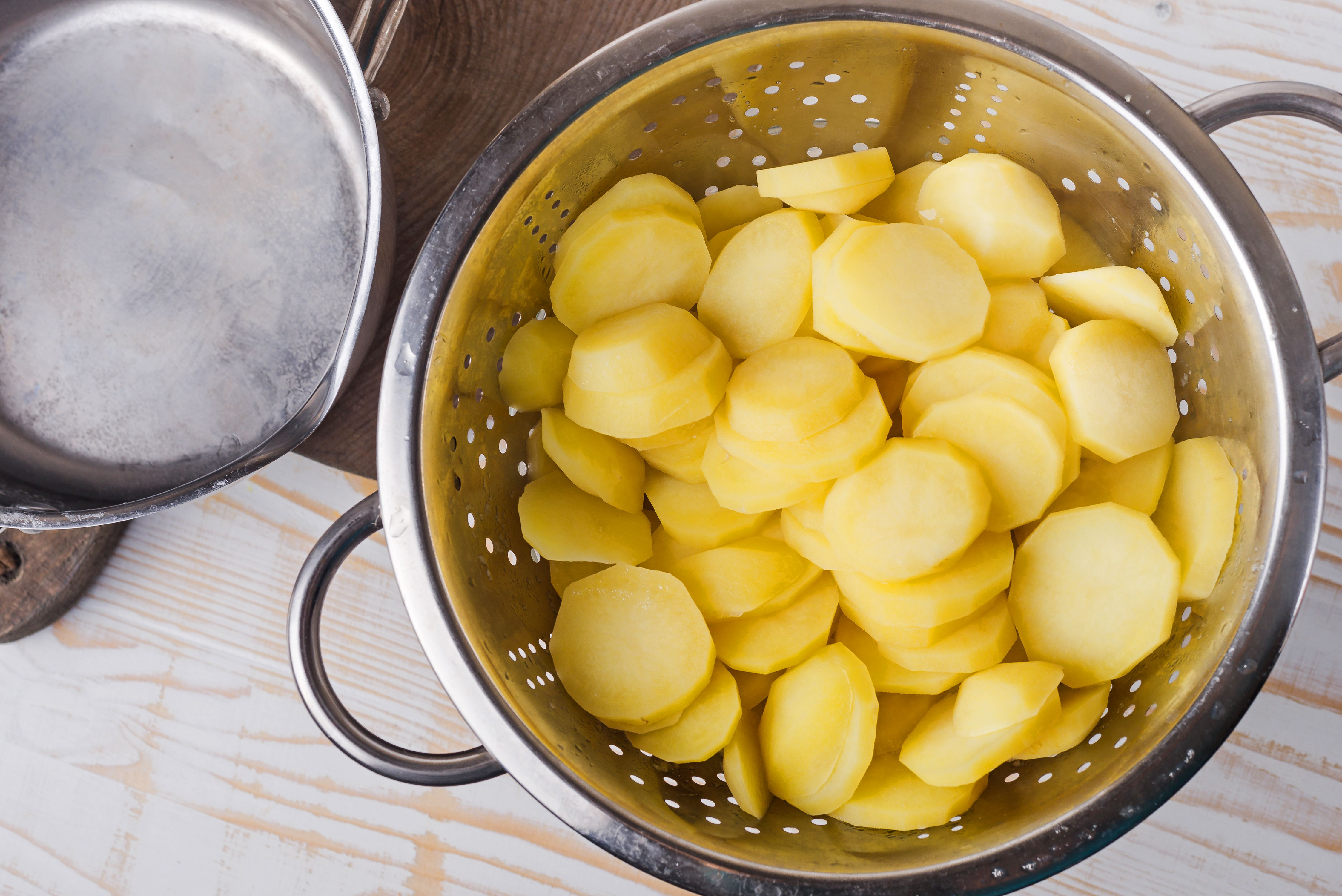 Place potatoes in colander