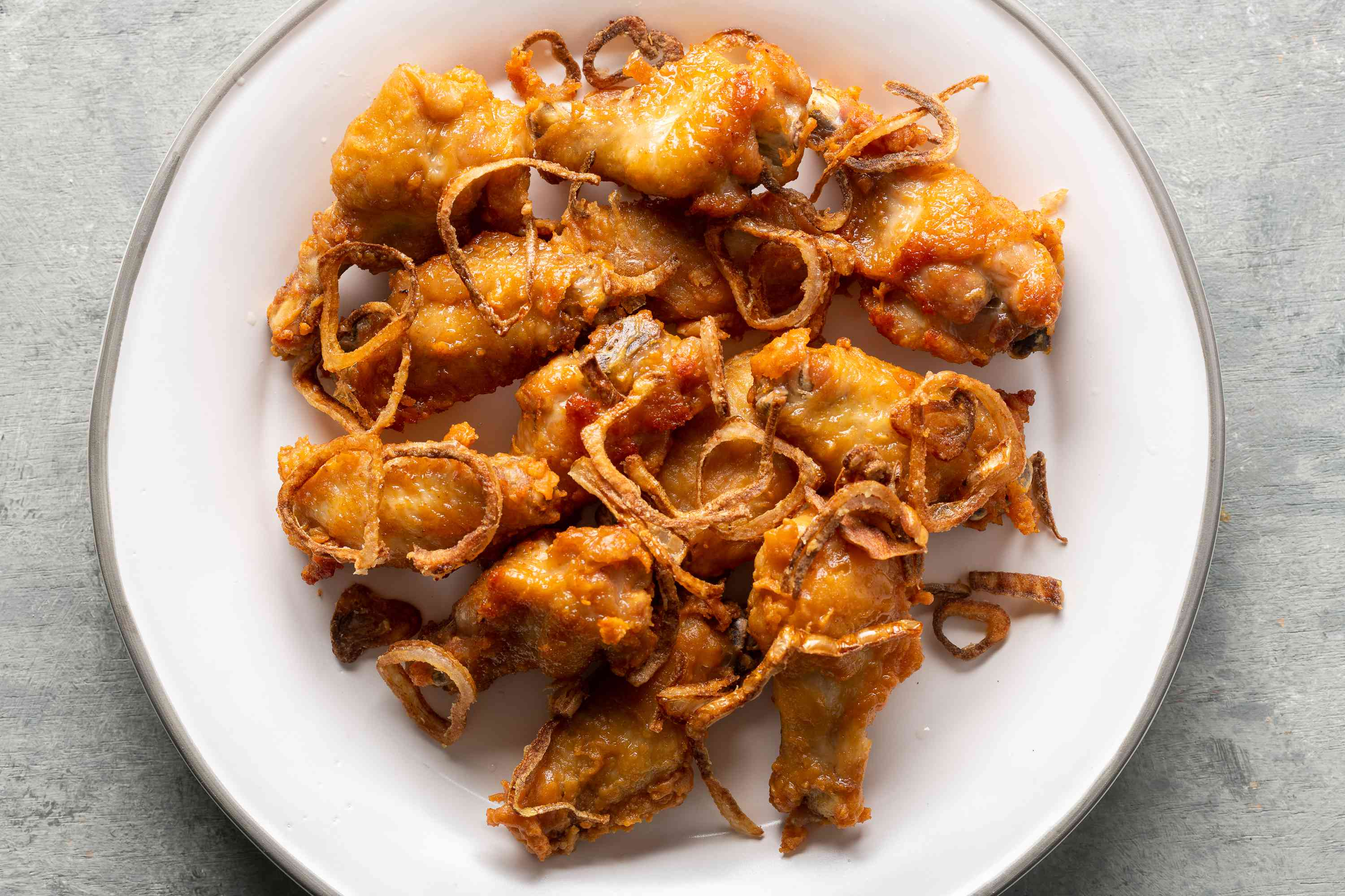 Thai fried chicken wings and fried shallots