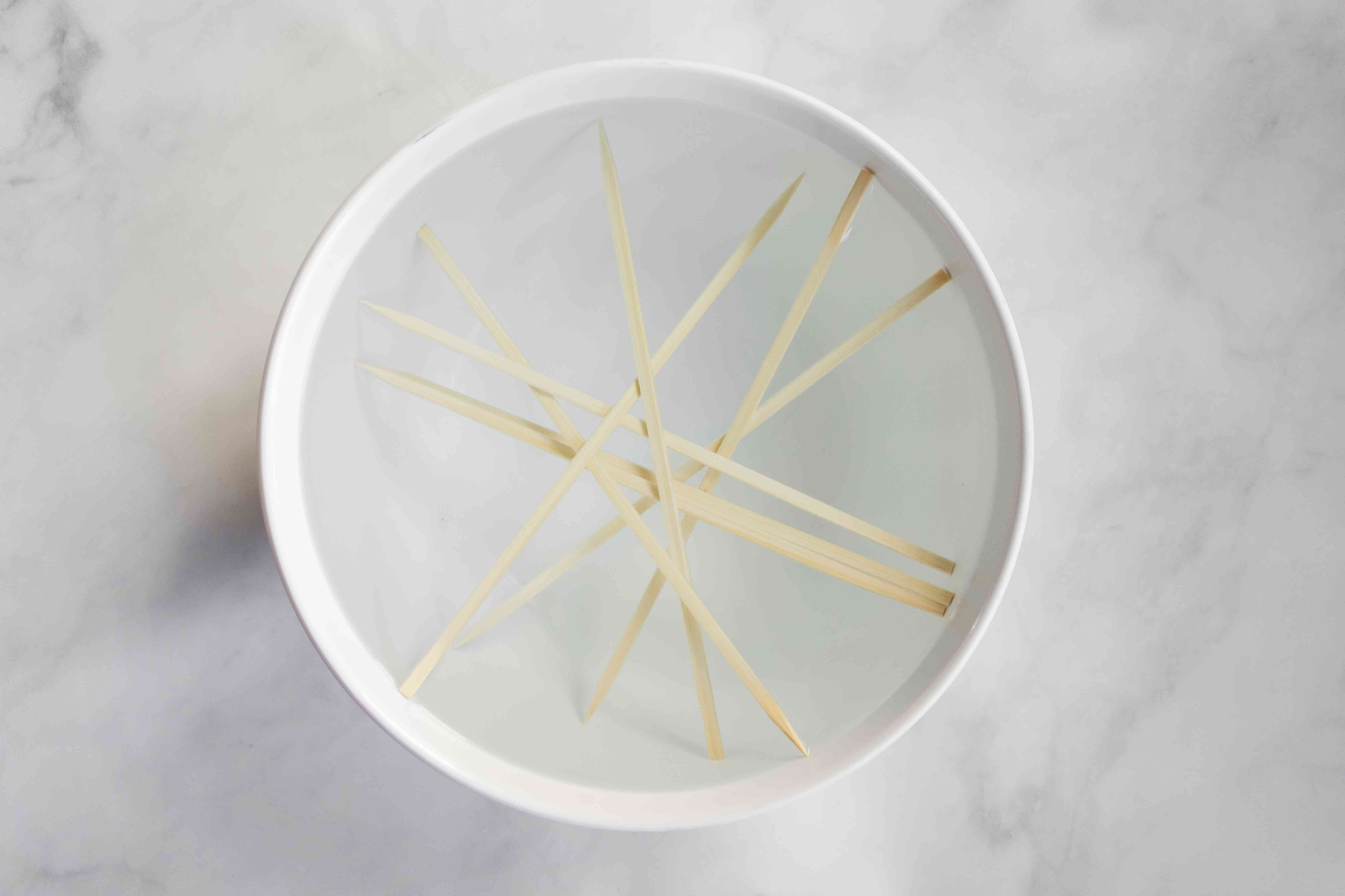 bamboo sticks in a bowl with water