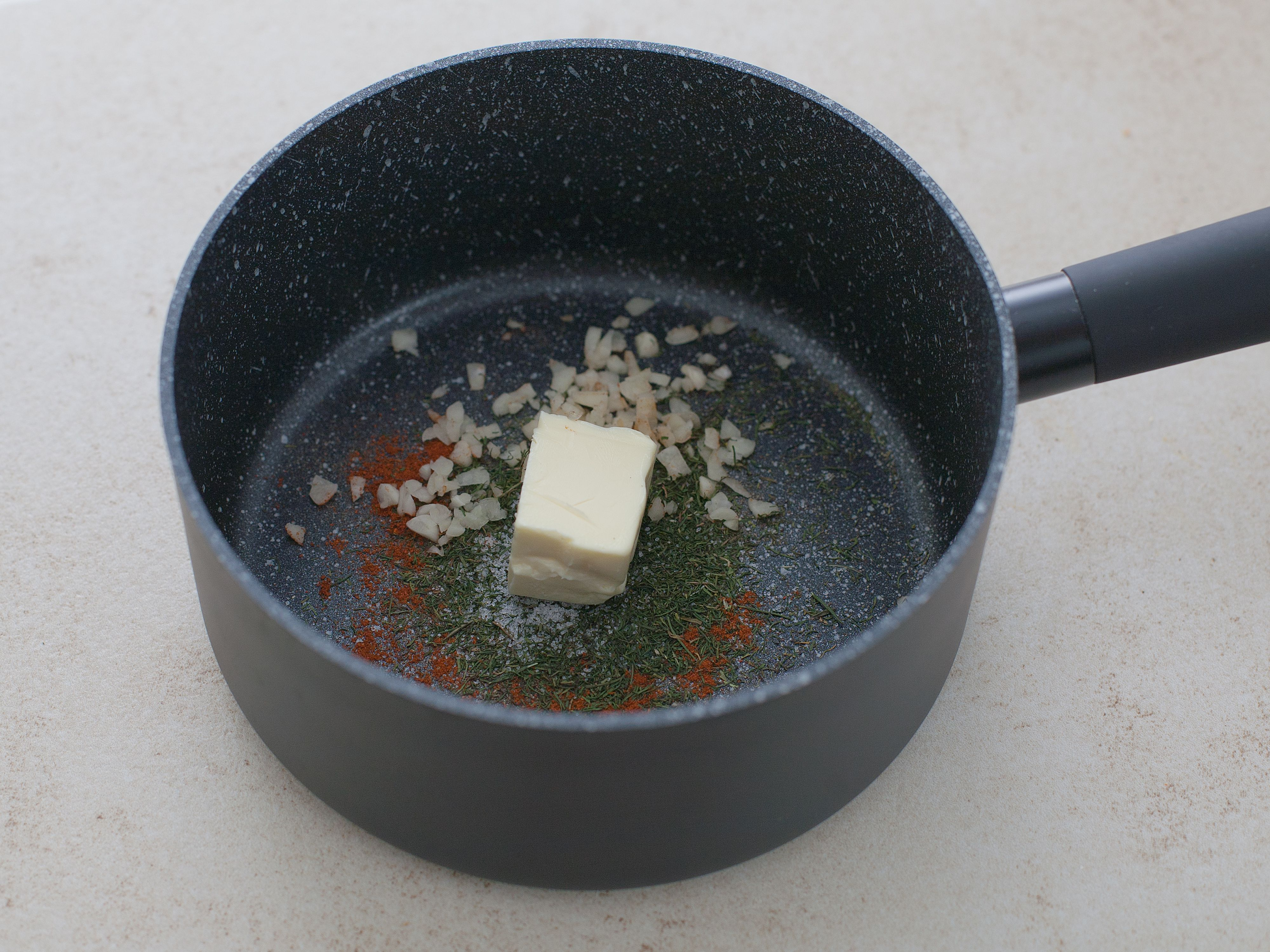 Melting butter and spices in a pot