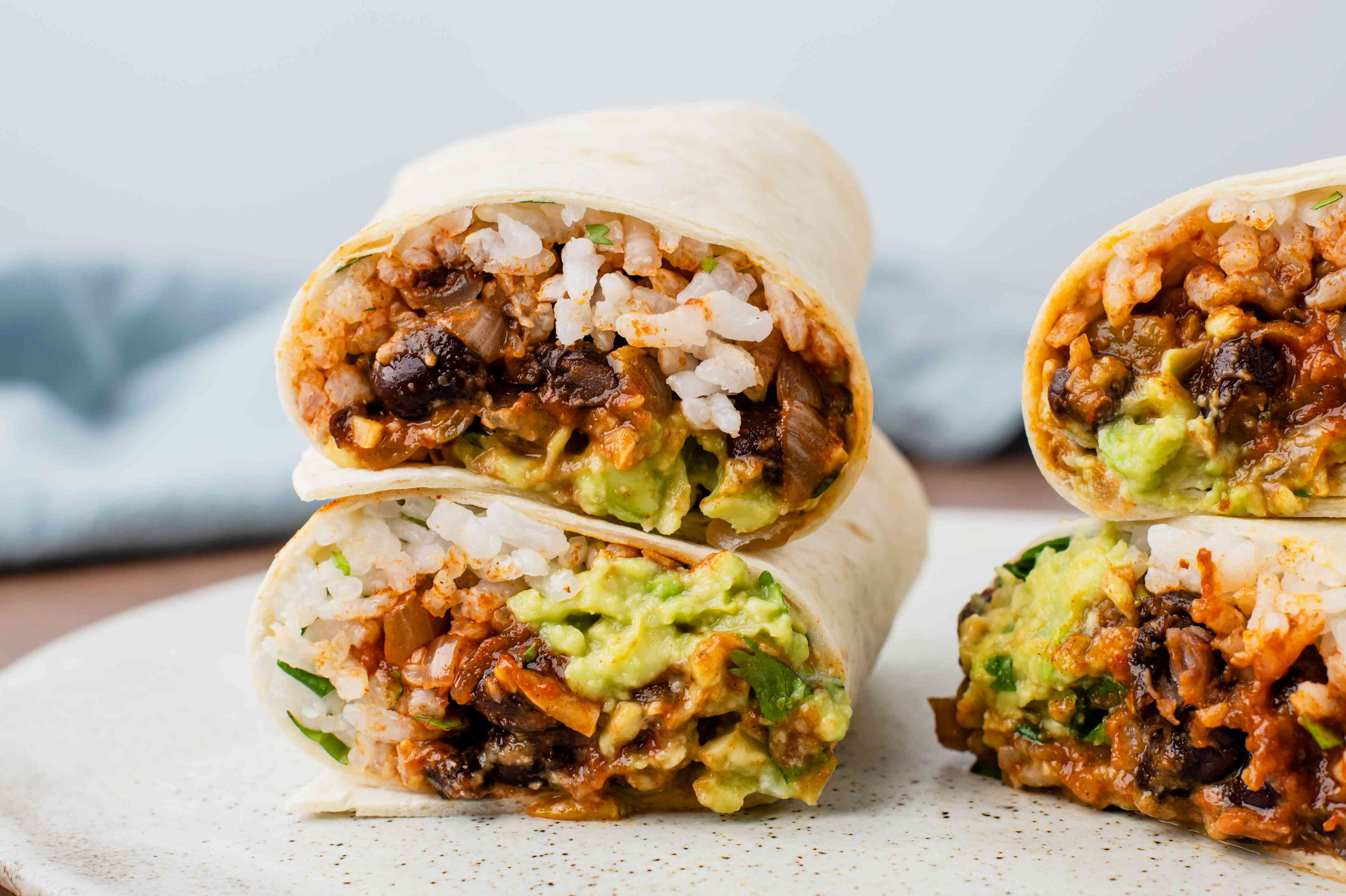 Vegetarian bean and rice burritos sliced in half and ready to serve