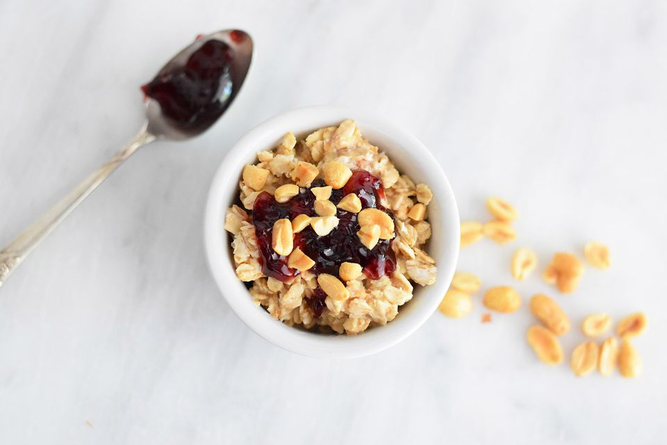 Peanut butter and jelly overnight oats topped with crushed peanuts