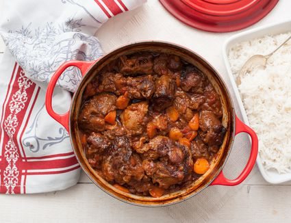 Braised oxtail recipe in a pot with white rice on the side
