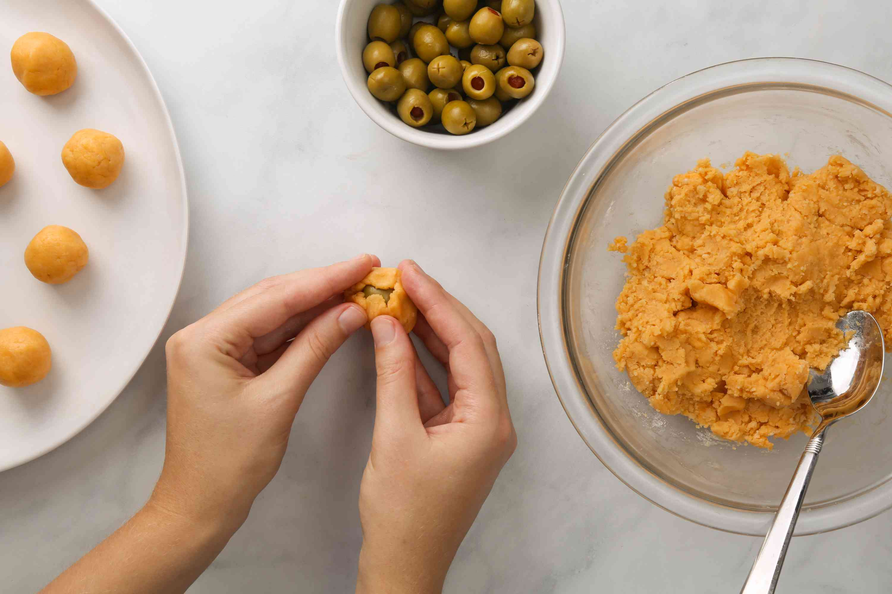 Form into small balls around olives