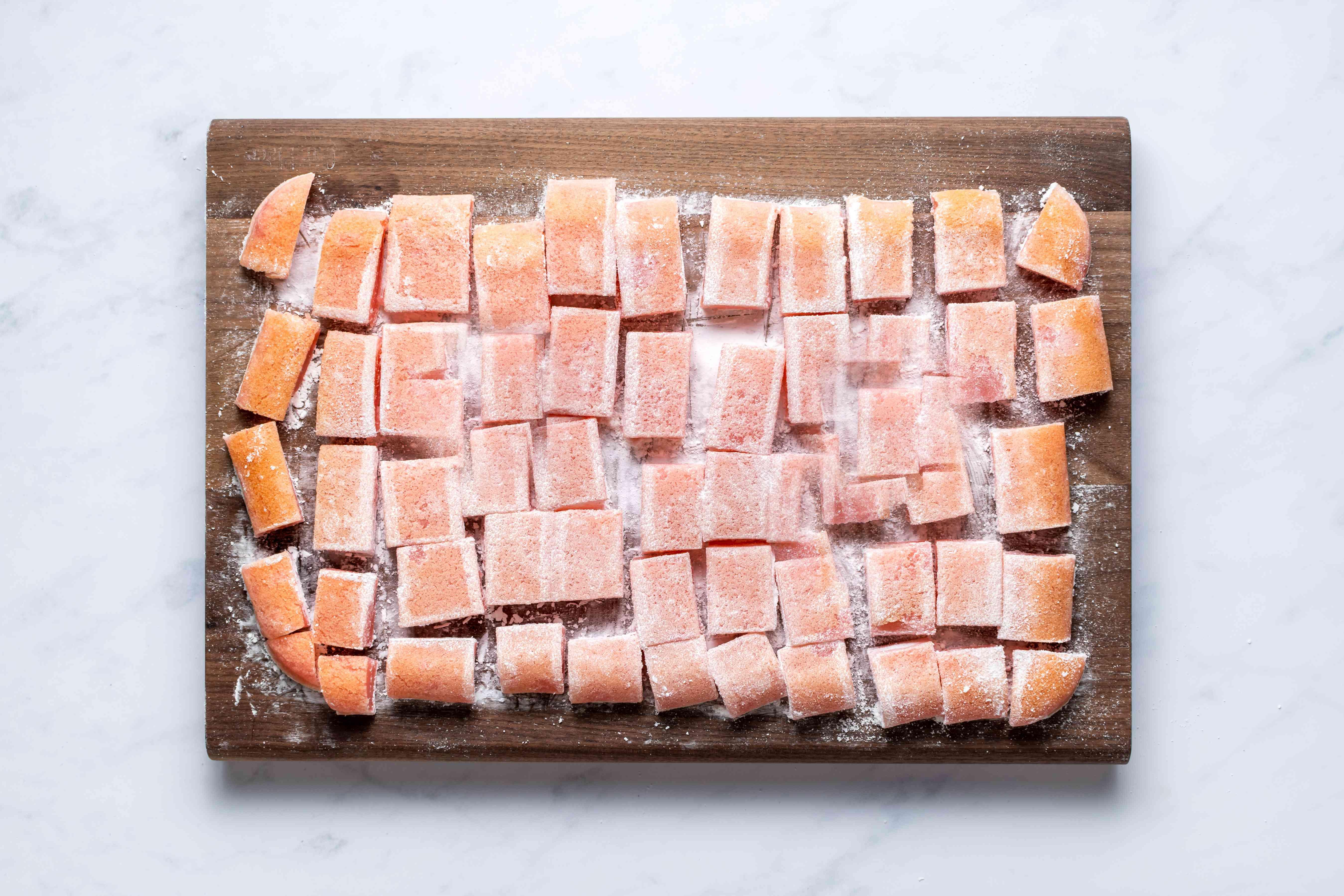 potato starch coated Chi Chi Dango Mochi on a cutting board
