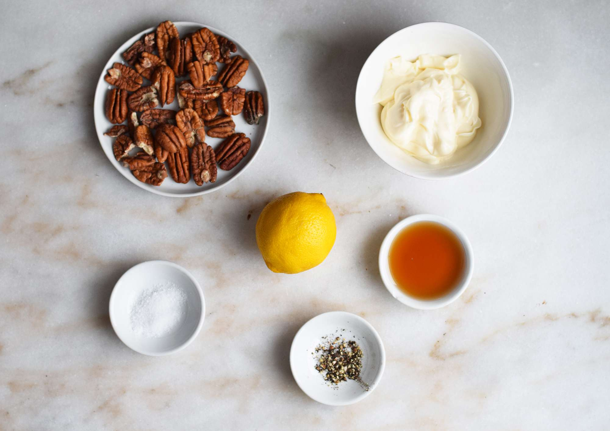 ingredients for maple pean aioli on a marble board