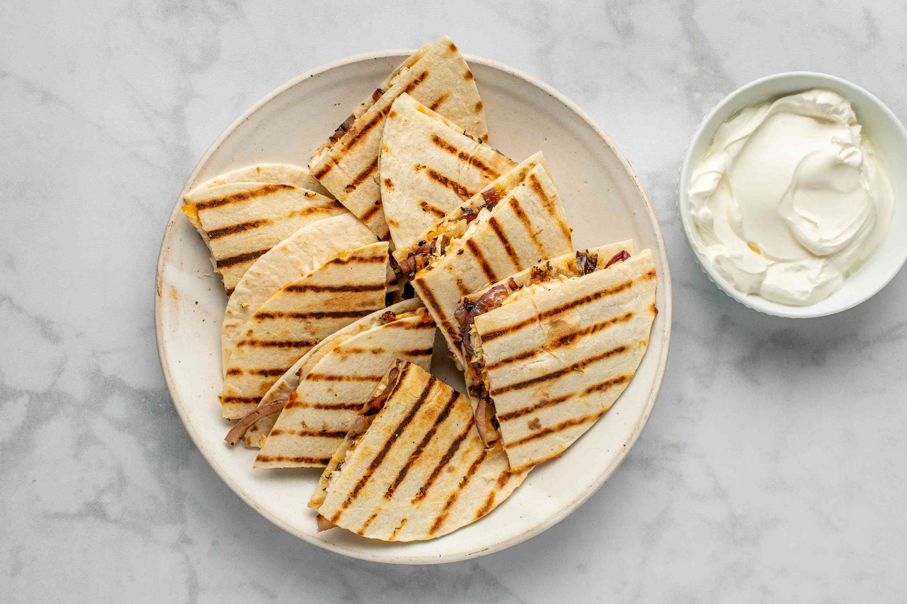 Grilled Chicken Quesadilla served with a side of sour cream