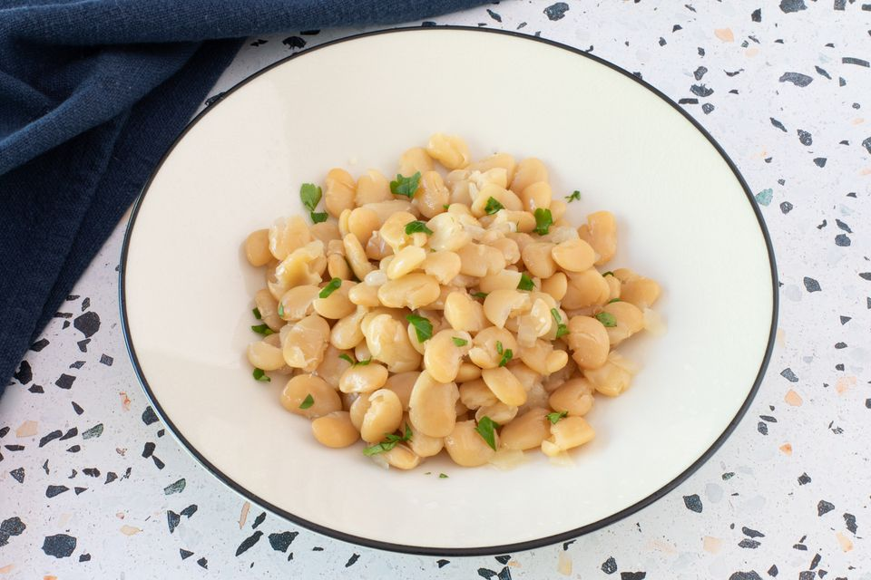 Instant Pot cooked lima beans in a dish with parsley.