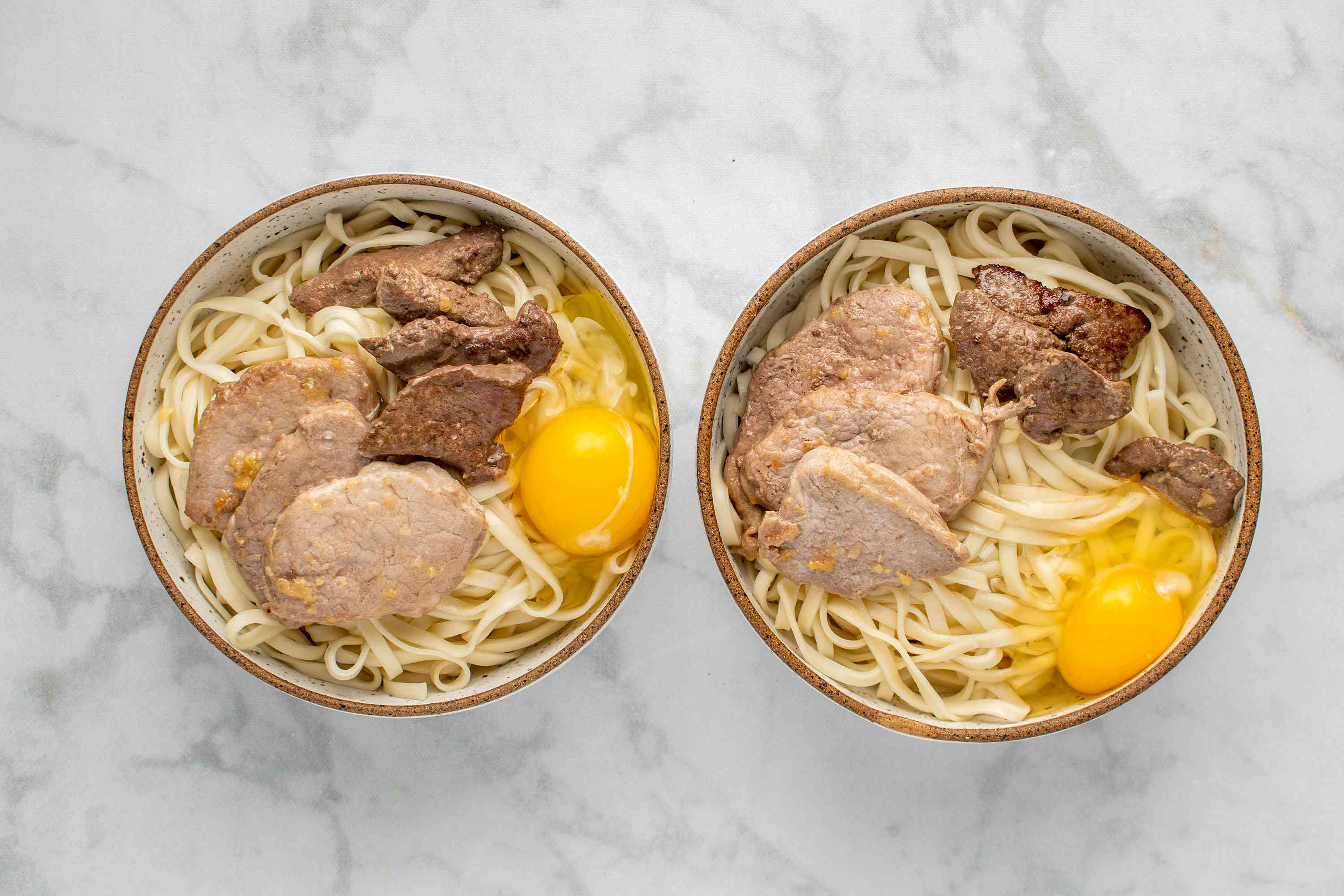Crack an egg over the noodles and meat in a bowl