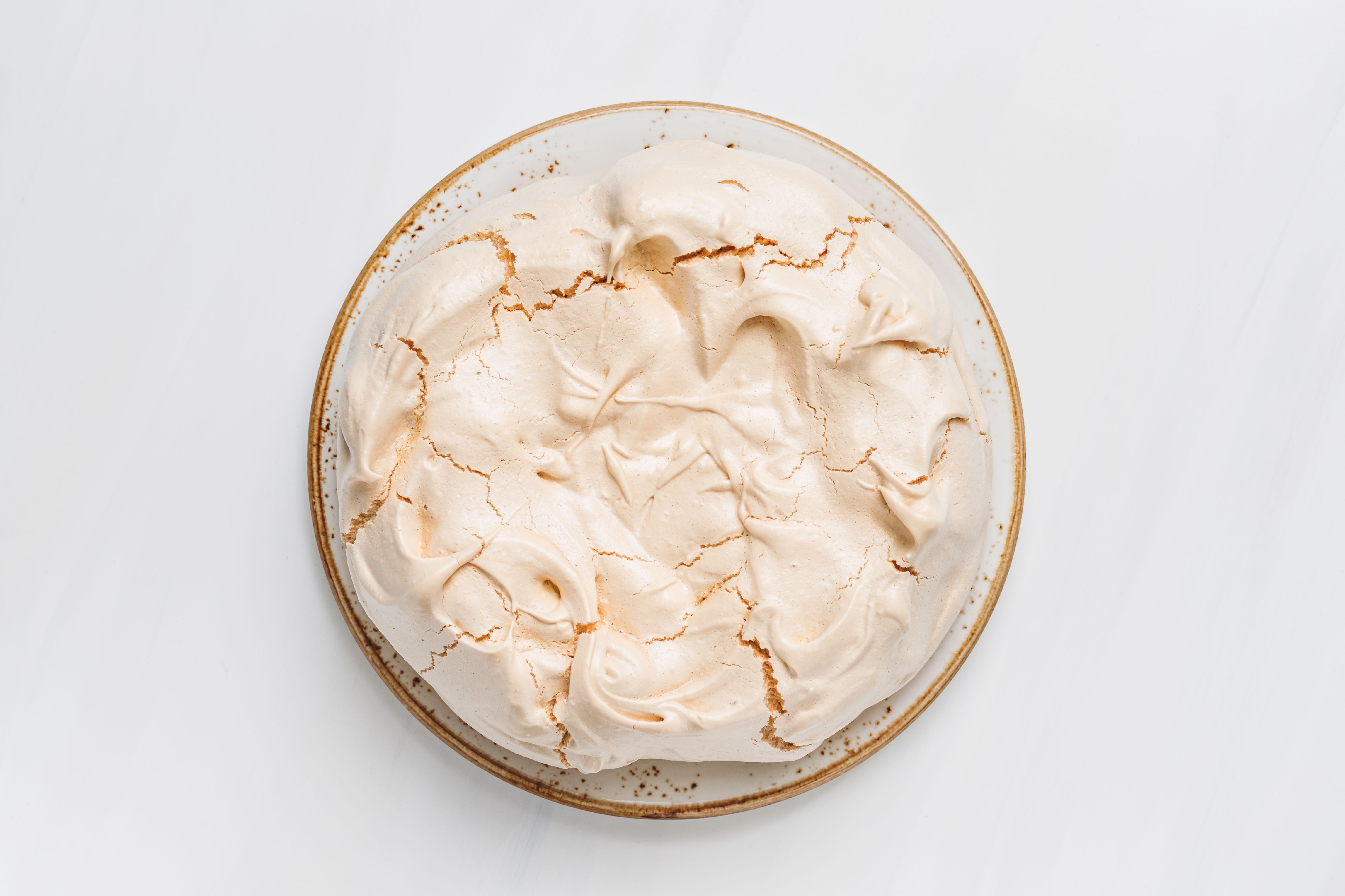 Baked meringue on a plate