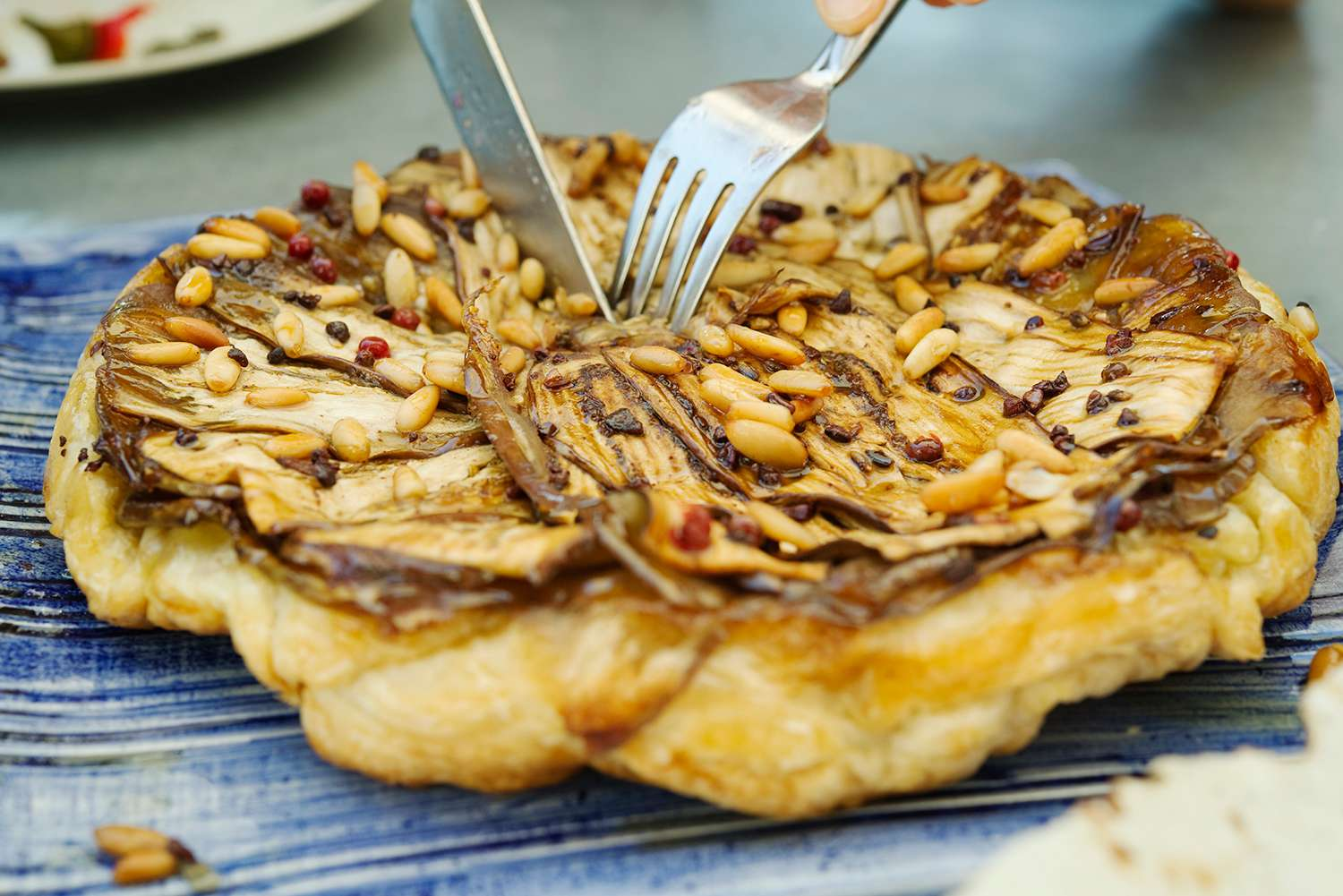 Tatin eggplant with pine nuts and groats cocoa