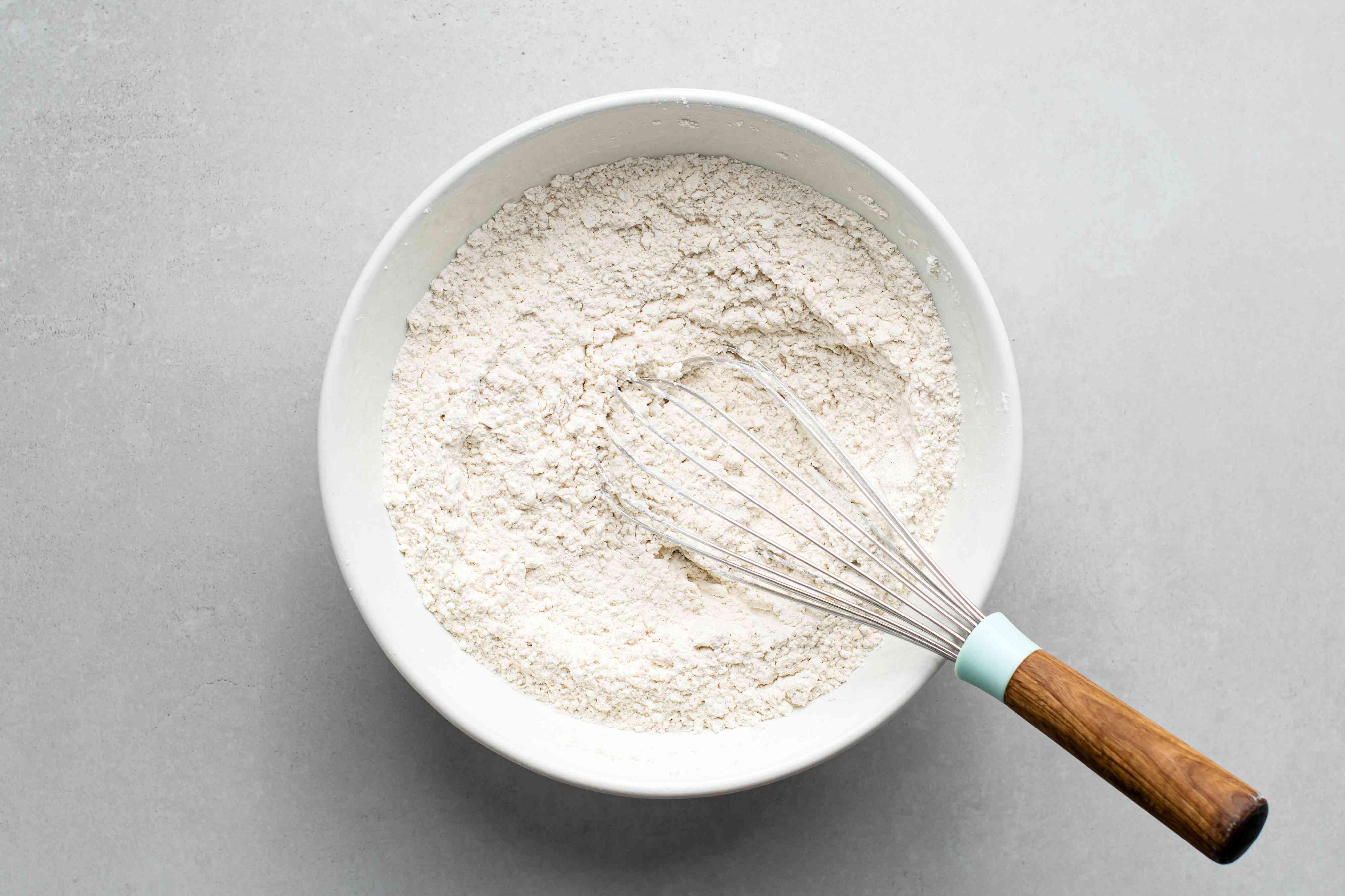 flour, sugar, baking powder, cinnamon, and salt together in a large bowl