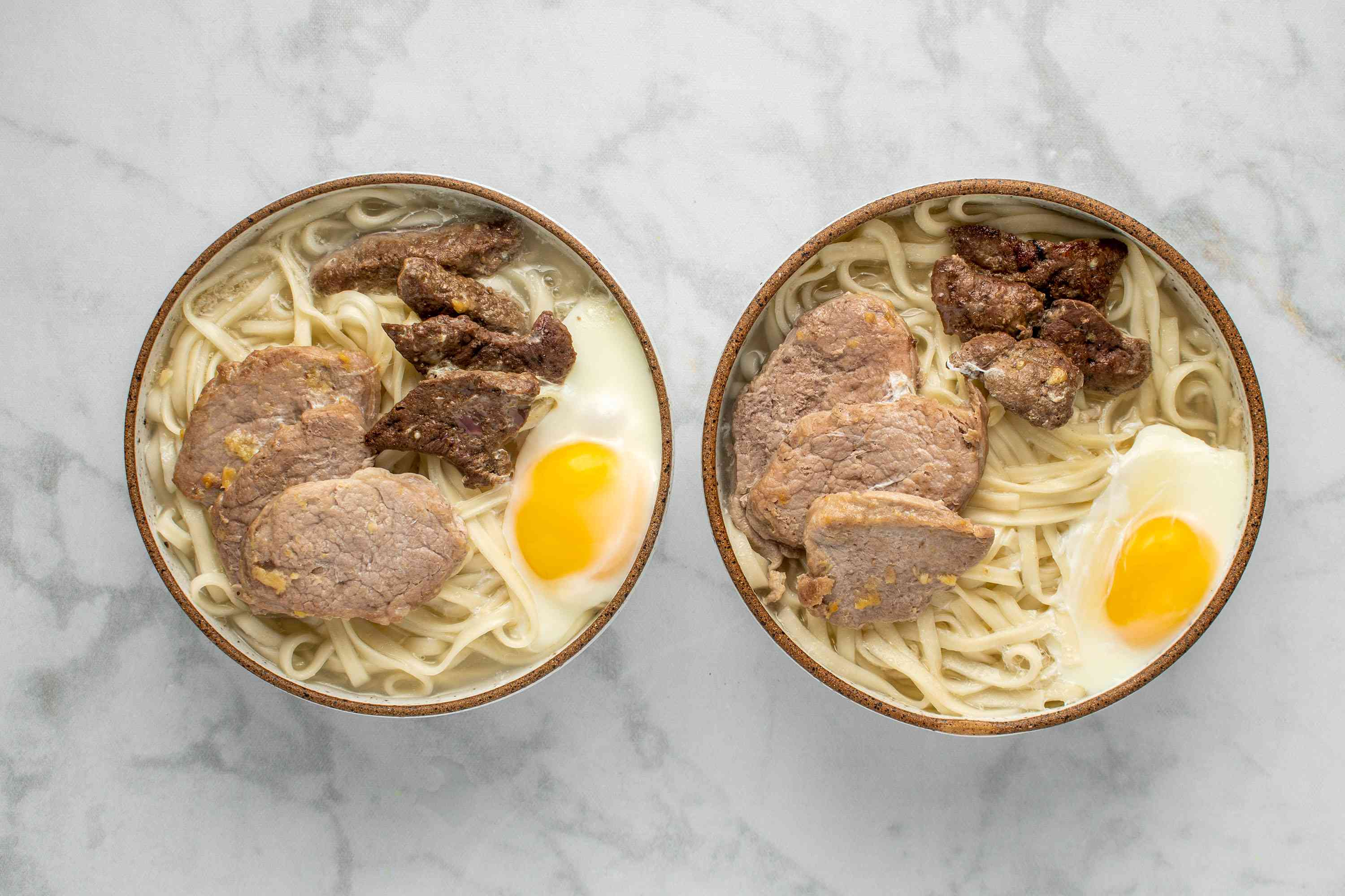 broth added to the noodles, meat and egg in the bowl