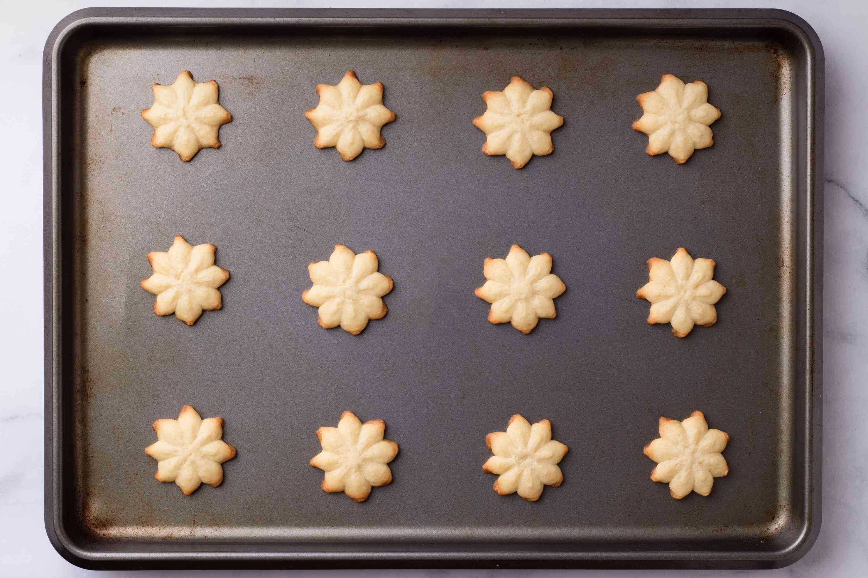 Cream Cheese Cookie Press on a baking sheet